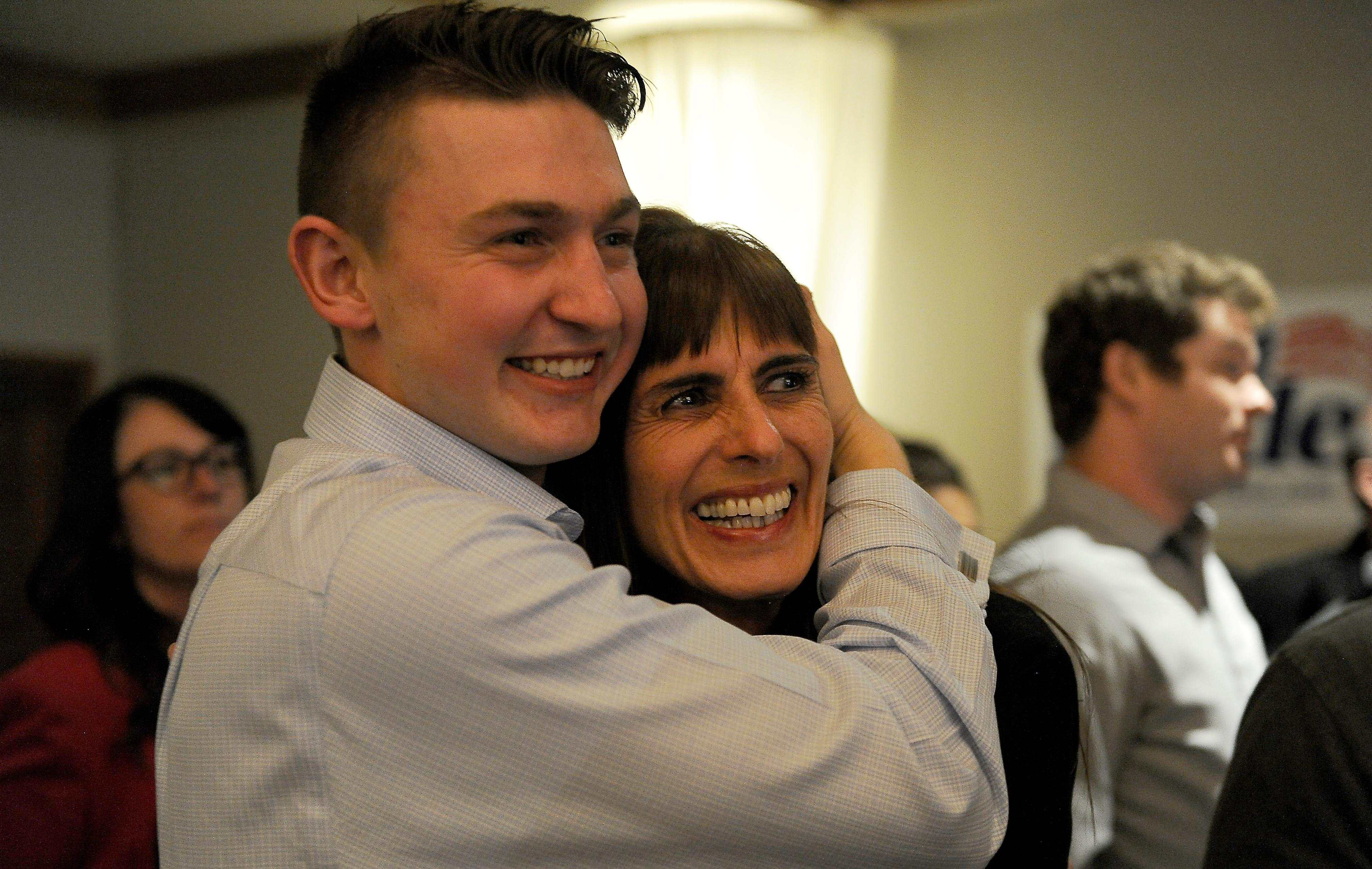 Andy Atkinson / Mail Tribune{ } Kim Wallen gets a hug from her son Eric after first results came in with a 7% lead in her favor at the Republican party held at the Rogue Valley Country Club Tuesday evening.