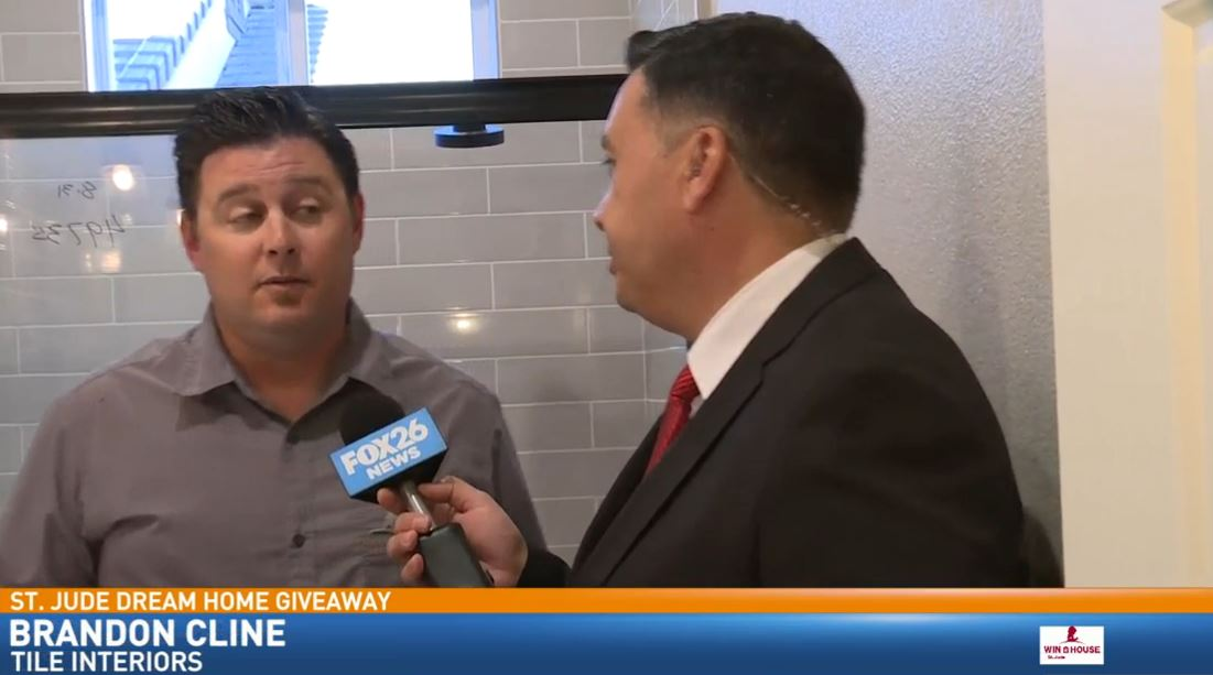 Justin Willis in the St. Jude Dream Home bathroom with Brandon Cline of Tile Interiors