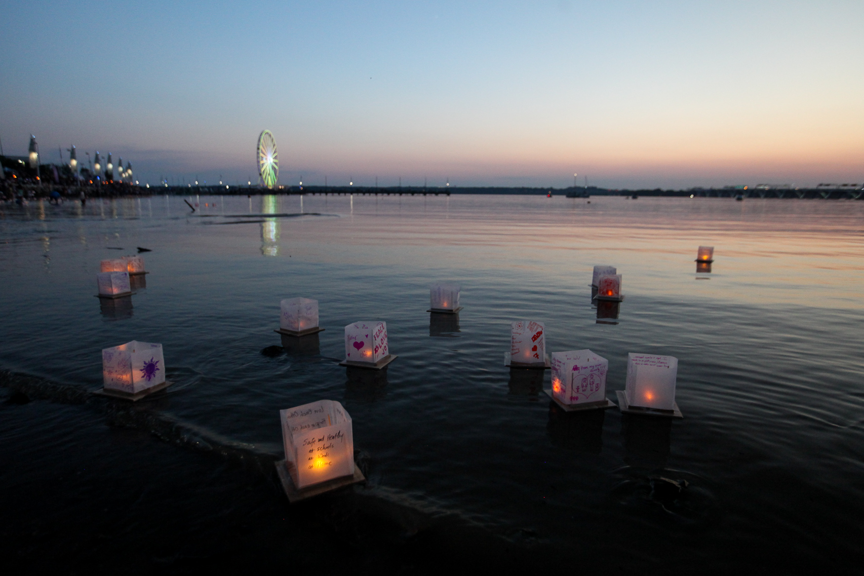 Thousands of paper lanterns inscribed with drawings, well wishes, hopes and private letters were set afloat on National Harbor on Saturday, August 4. The Water Lantern Festival, which is put on by the production company One World, gives guests the chance to enjoy some ultra-Instagrammable catharsis by encouraging them to put their hopes, dreams and worries on the paper lanterns and setting them out to float. The lanterns are illuminated by flickering LED lights, so the production team can pick up the lanterns later. (Amanda Andrade-Rhoades/DC Refined)