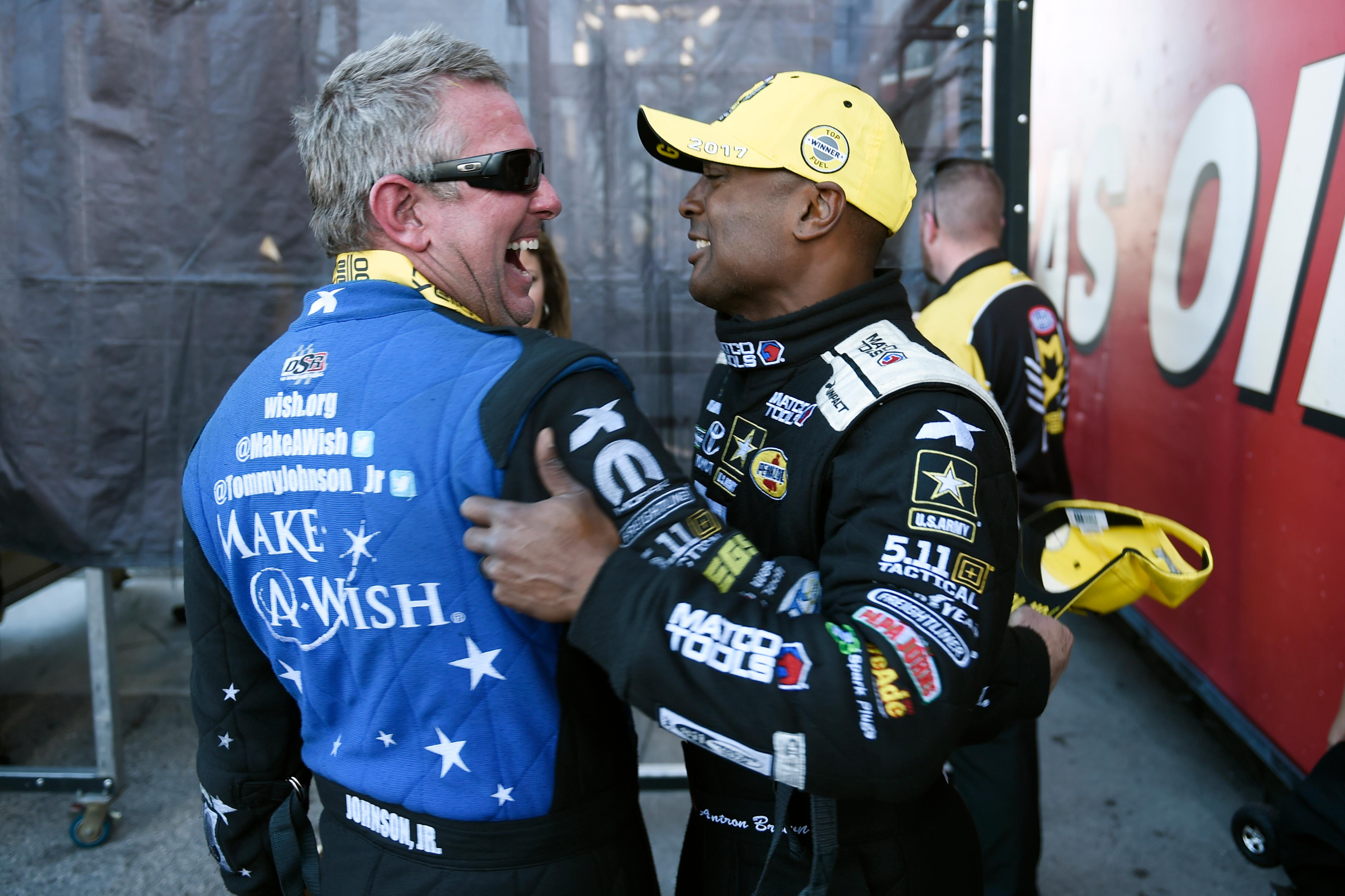 Funny Car winner Tommy Johnson Jr. and Top Fuel winner Antron Brown celebrate their victories during the NHRA DENSO Spark Plug Nationals at The Strip at the Las Vegas Motor Speedway Sunday, April 2, 2017. (Sam Morris/Las Vegas News Bureau)