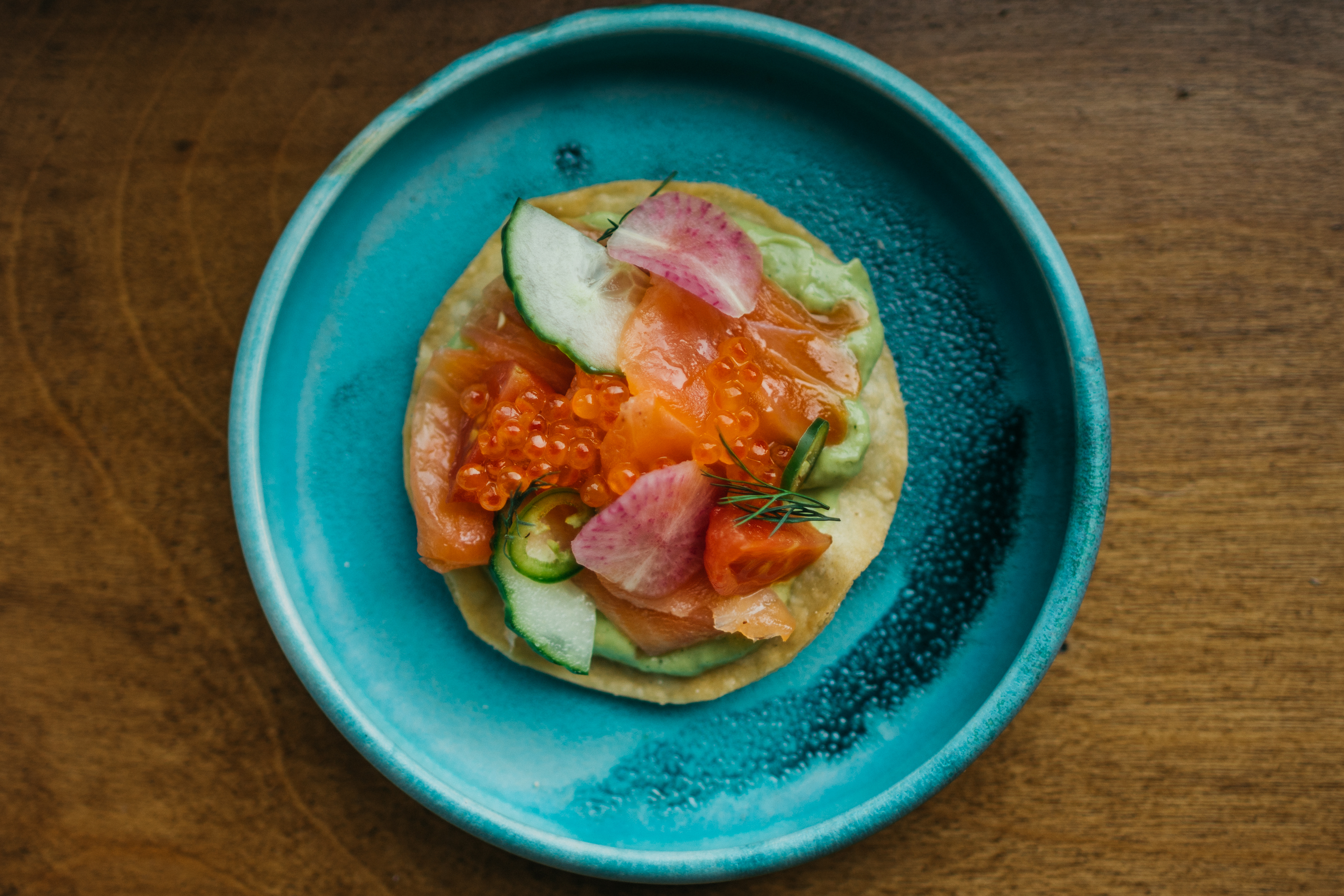 Upstairs, you'll find elegant Latin small plates like this salmon lox tostada at Buena Vida. (Image:Timothy Yantz)