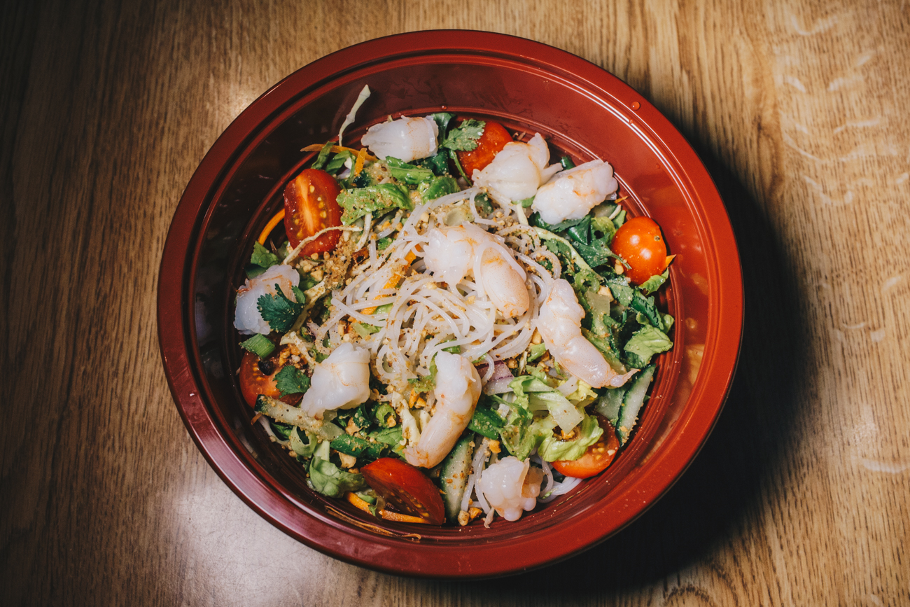 Cold noodle salad with shrimp: cabbage, carrots, cucumber, cilantro, roasted peanuts, tomatoes, vermicelli noodles, and Cambodian vinaigrette{ }/ Image: Catherine Viox // Published: 2.24.19