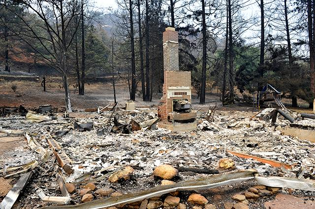Jamie Lusch / Mail Tribune<br>A fireplace is all that remains standing from a home lost in the  Klamathon fire on Cottonwood Creek Road near the town of Hornbrook.