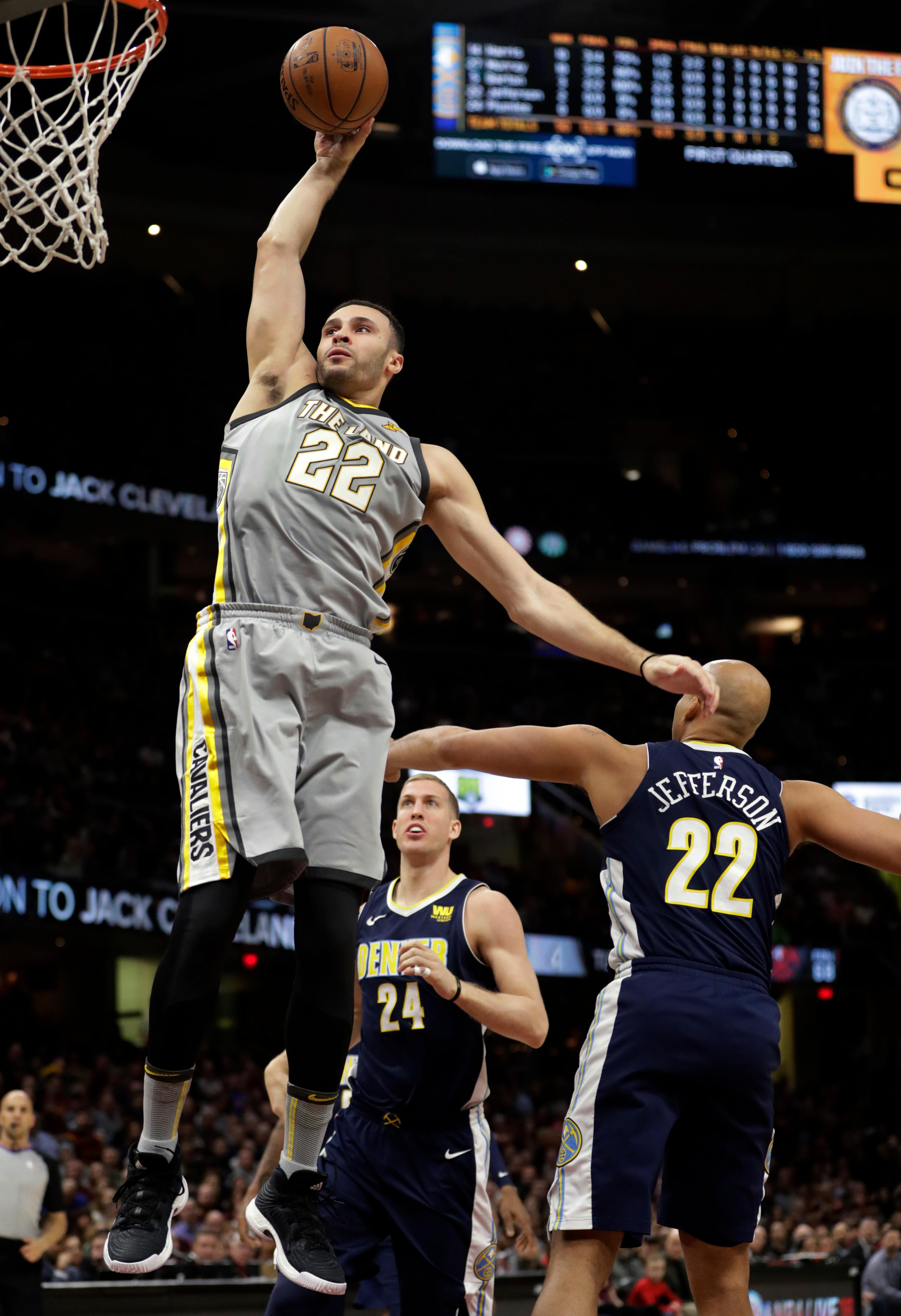 Cleveland Cavaliers' Larry Nance Jr. (22) dunks the ball against the Denver Nuggets in the first half of an NBA basketball game, Saturday, March 3, 2018, in Cleveland. (AP Photo/Tony Dejak)