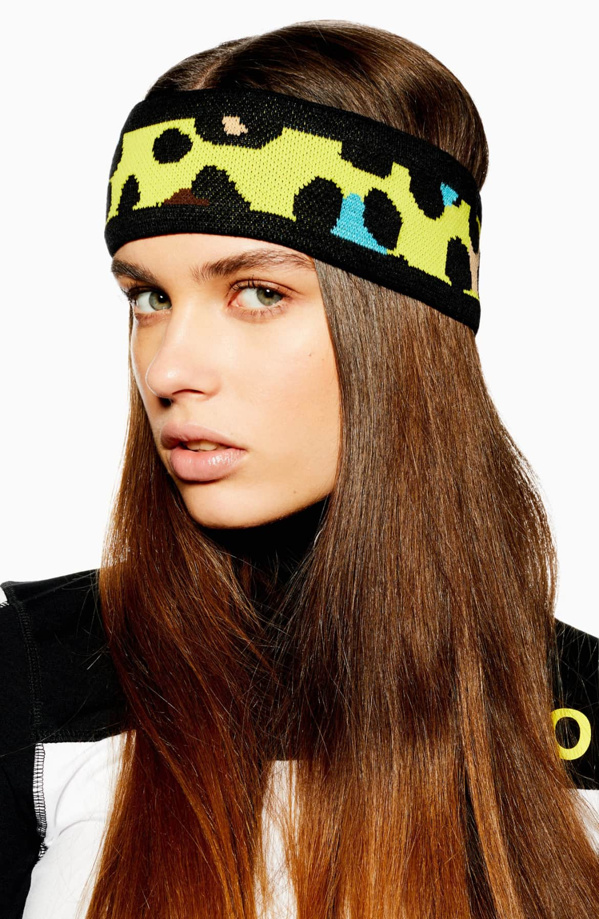 Elevate your cold-weather style with a cozy ear-warming headband featuring intarsia-knit graphics. $22 (Image: Nordstrom){ }