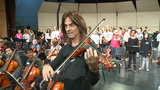 Trans-Siberian Orchestra Mark Wood helps Oshkosh students electrify their musical strings