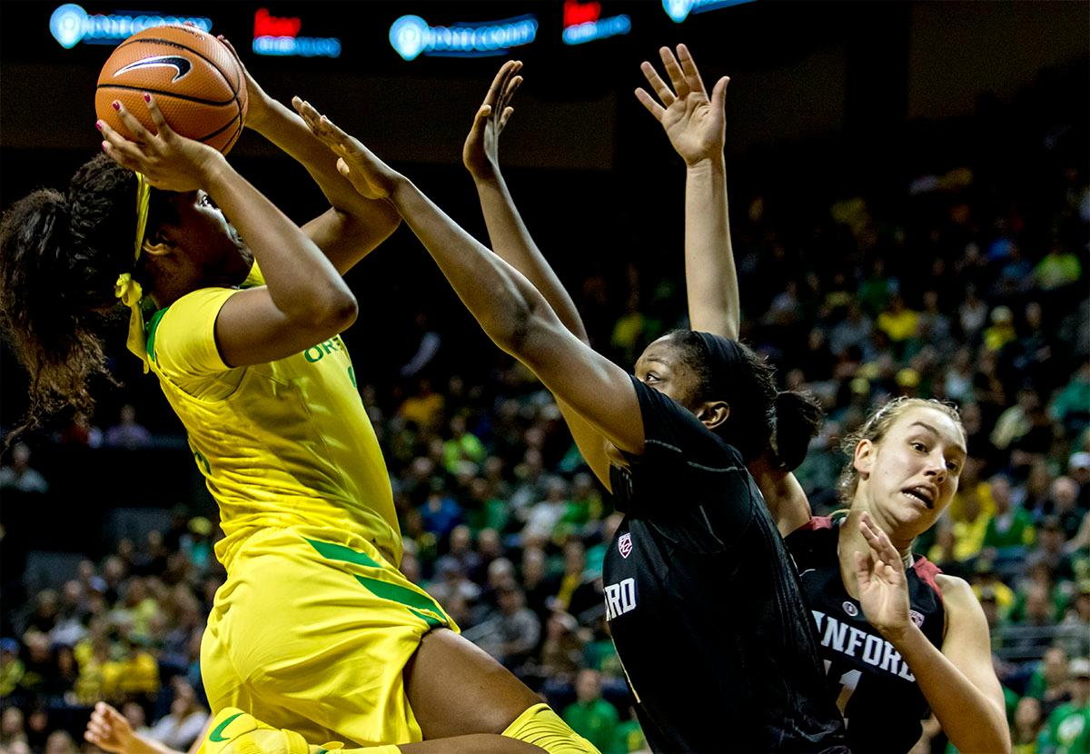 The Duck's Ruthy Hebard (#24) jumps up for a shot as the Cardinals defend. The Stanford Cardinal defeated the Oregon Ducks 78-65 on Sunday afternoon at Matthew Knight Arena. Stanford is now 10-2 in conference play and with this loss the Ducks drop to 10-2. Leading the Stanford Cardinal was Brittany McPhee with 33 points, Alanna Smith with 14 points, and Kiana Williams with 14 points. For the Ducks Sabrina Ionescu led with 22 points, Ruthy Hebard added 16 points, and Satou Sabally put in 14 points. Photo by August Frank, Oregon News Lab