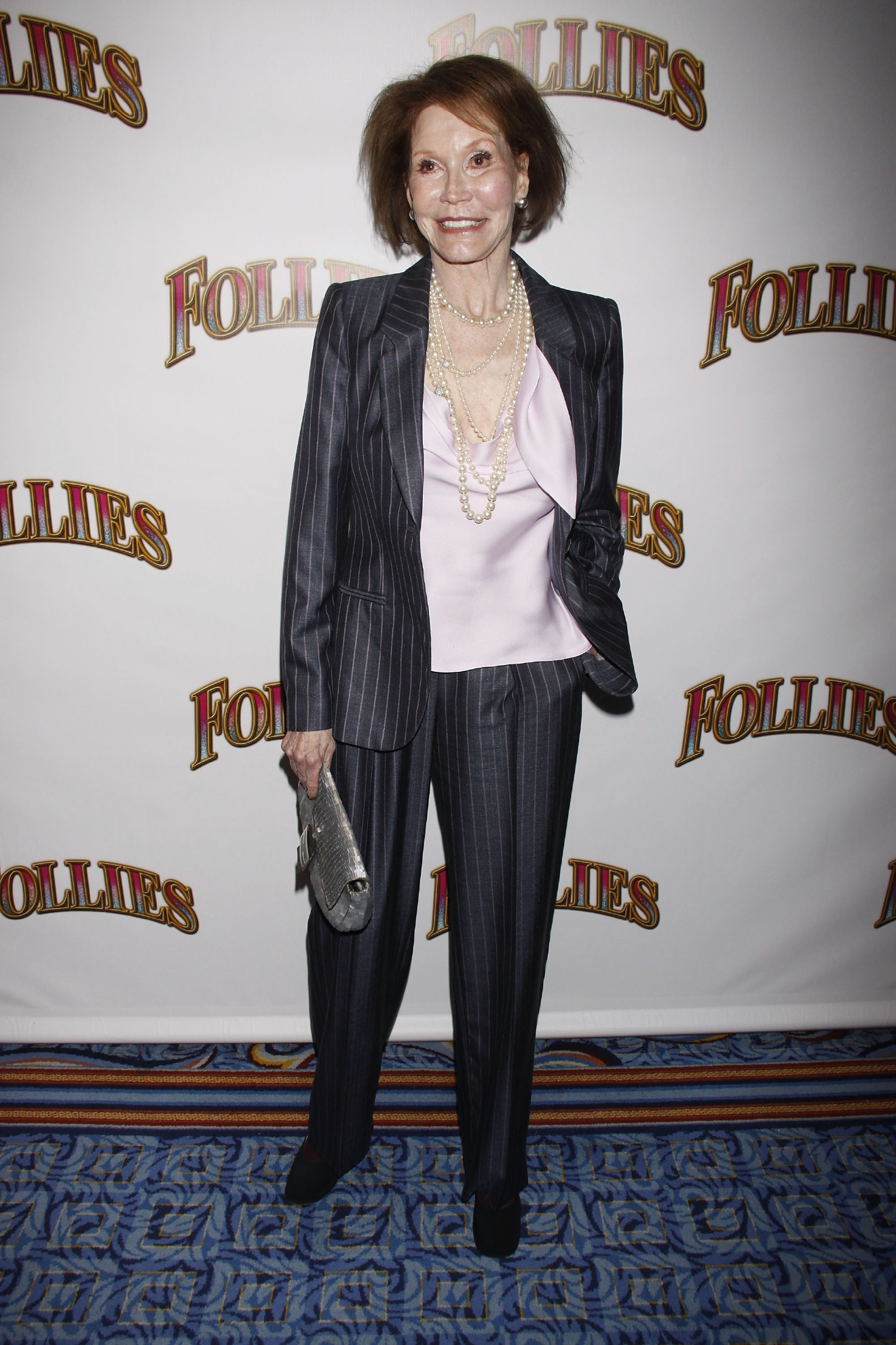 Actress Mary Tyler Moore put on a brave face to attend the opening night of pal Bernadette Peters' stint in Follies on Monday (12Sep11) while battling a mystery health issue. The beloved TV and movie veteran was clearly struggling - half her face appeared to be swollen. The star's publicist is still trying to determine why Moore appeared so ill on the Broadway red carpet, but she has been battling health issues for some time. She has battled diabetes since the late 1960s and and alcoholism. Earlier this year (11) she underwent elective brain surgery to remove a benign tumour. But she appeared to be in great spirits and fine form in July (11), when she attended the Summer at Broadway Barks charity event. Just last week (ends09Sep11), she was named the recipient of the 2011 Screen Actors Guild Life Achievement Award. The actress, who is best known for her portrayal of homemaker Laura Petrie in The Dick Van Dyke Show and as title character Mary Richards in iconic sitcom The Mary Tyler Moore Show, will be the 48th person to pick up the accolade when the Screen Actors Guild Awards take place in January (12).  Mary Tyler Moore Opening night of the Broadway musical production of 'Follies' at the Marquis Theatre - Arrivals  Where: New York City, United States When: 12 Sep 2011 Credit: WENN