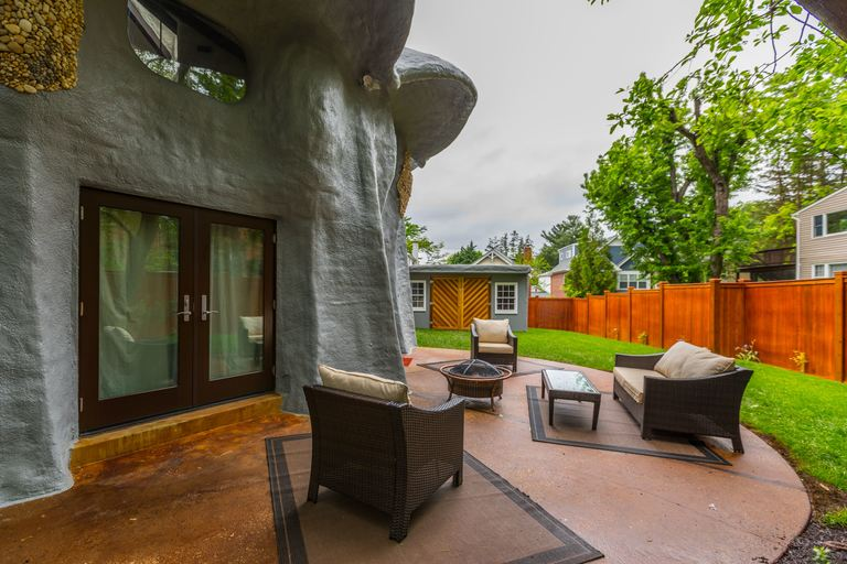 "After a major interior renovation, the whimsical Bethesda ""mushroom house"" is for sale for the first time since 2015, when it sold for $920,000. The current owner added a loft above the living room, remodeled the kitchen and dug out the basement in order to raise the ceiling height. The 6-bedroom/4.5-bath house (with a 1-bed/1-bath guest house) is now on the market for $1,549,000 with Compass realtor Jill Schwartz. (Image: Courtesy Compass)"