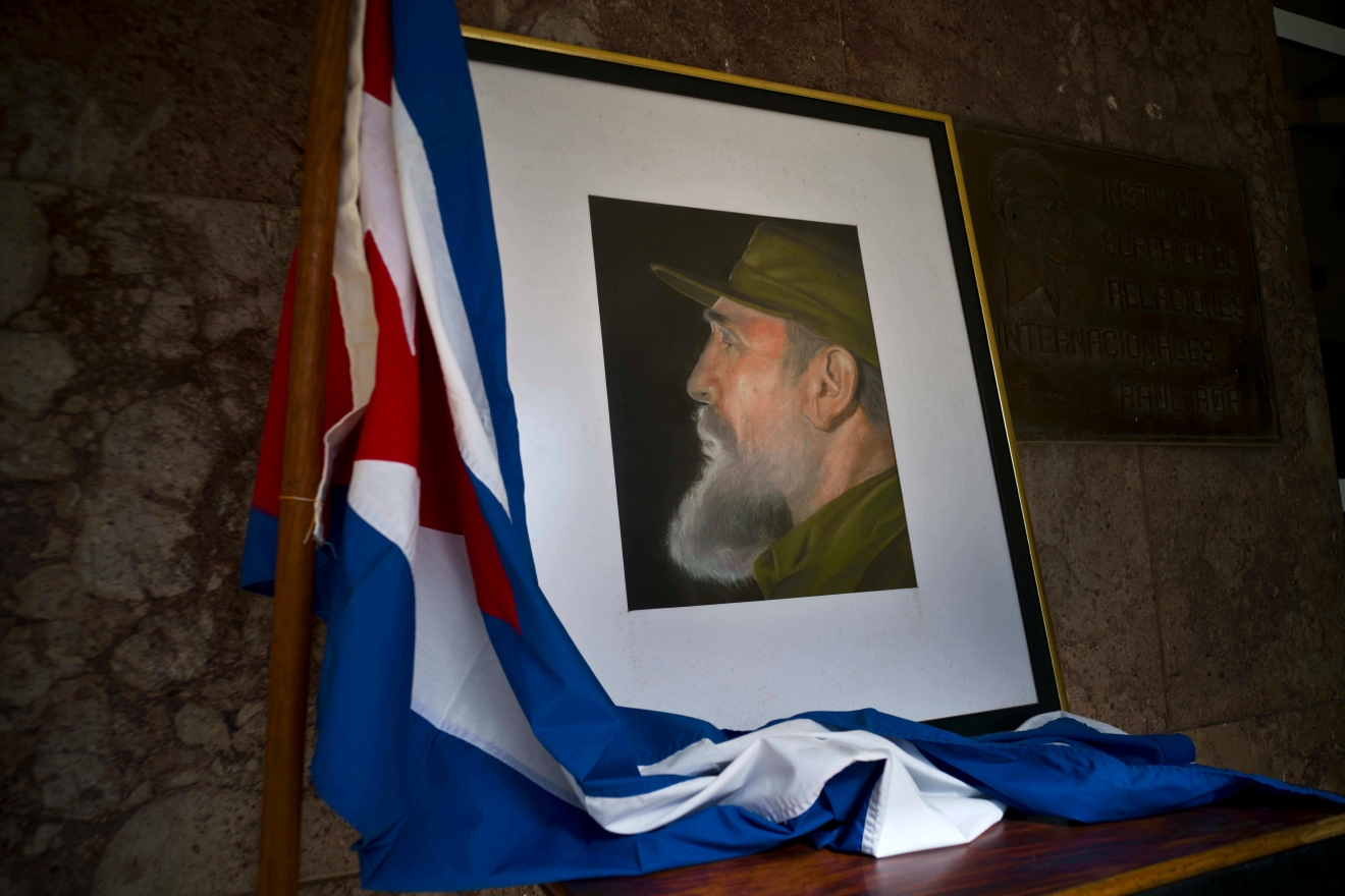 An image of Fidel Castro and a Cuban flag are displayed in honor of Castro the day after he died, inside the foreign ministry in Havana, Cuba, Saturday, Nov. 26, 2016.  (AP Photo/Ramon Espinosa)