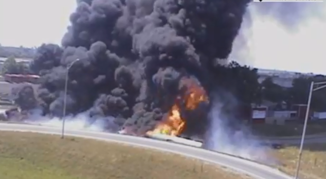 (image: WPMI) Overturned tanker truck causes giant fire I-10 at Virginia St.