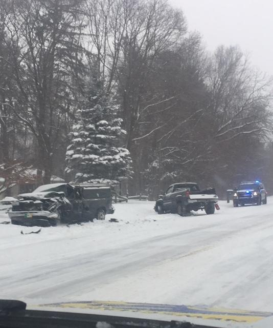 An accident between two pickup trucks sent two people to the hospital Friday, Feb. 9, 2018, in Richland, Michigan. (WWMT/Jessica Wheeler)