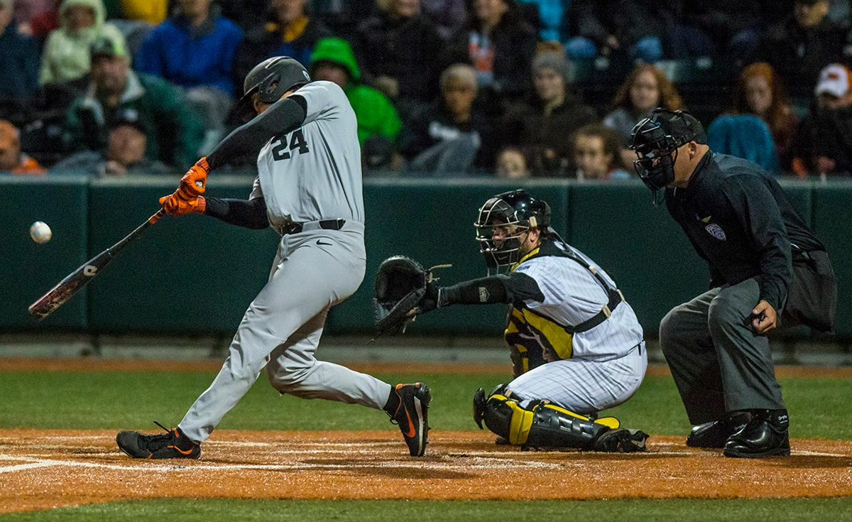 Oregon State Beavers KJ Harrison (#24) attempts to swing at the ball. The Oregon State Beavers defeated the Oregon Ducks 5-4 in game two of the Civil War three-game series on Friday night at PK Park. This loss is the fifth straight loss for the Ducks, in which four have been by a single run. The final game of the Civil War series will be on Saturday, May 13th at 7pm. Photo by Rhianna Gelhart, Oregon News Lab