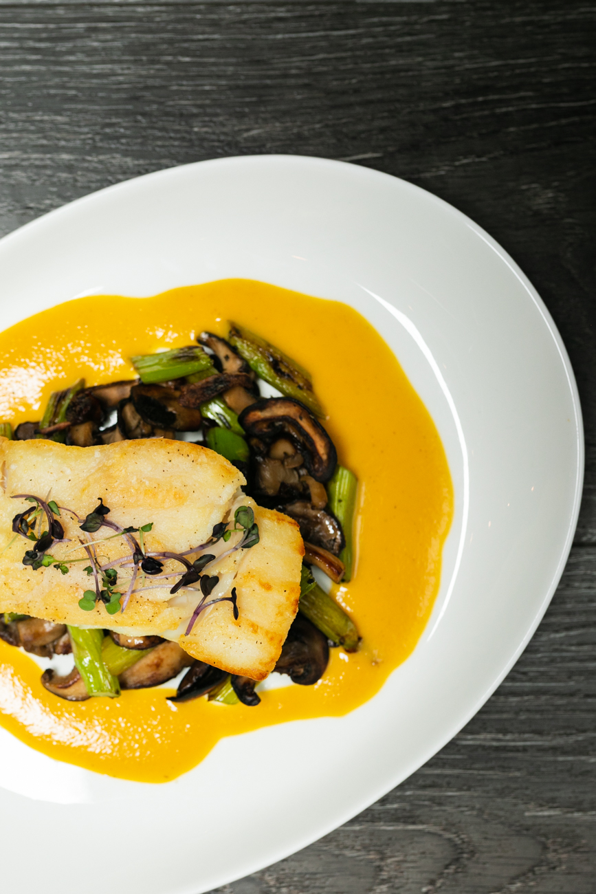 <p>Atlantic halibut served with asparagus, mushroom, and an orange corn reduction / Image: Amy Elisabeth Spasoff // Published: 11.28.18</p>