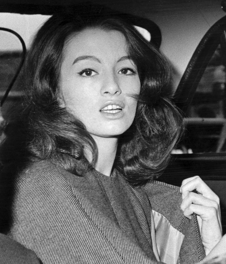 FILE - in this file photo dated  July 22, 1963 Christine Keeler, a principal witnesses in the vice charges case against osteopath Dr. Stephen Ward.  The model at centre of Profumo Affair, a scandal that rocked the political establishment and forced cabinet minister to resign, Keeler has died according to a statement Tuesday Dec. 5, 2017, by her family.  (AP Photo/FILE)