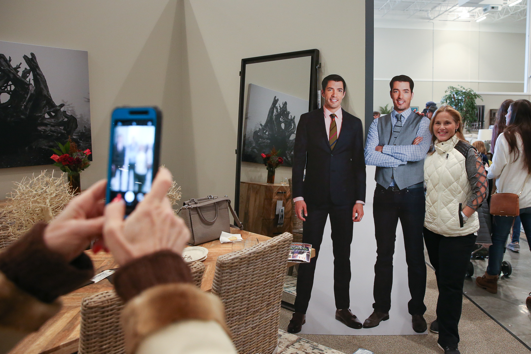 "Drew and Jonathan Scott, also known as HGTV's ""The Property Brothers,"" came to Sterling, VA to help Belfort Furniture open their new showroom on November 10. Diehard fans showed up at 6 a.m. - four hours before doors opened - in the hopes of catching a glimpse of The Scott brothers and snag a selfie. Hundreds of people showed up to the event and listened to The Scott brothers read their popular children's book 'Builder Brothers: Big Plans', to their younger fans. All the attendees had the chance to shop The Scott brothers' furniture line - Scott Living, as well as snack on breakfast items, request balloon animals and listen to live music. (Amanda Andrade-Rhoades/DC Refined)"