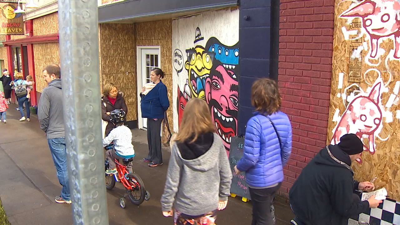 Volunteers help cleanup Seattle's Greenwood neighborhood after Wednesday's natural gas explosion. (KOMO Photo March 12. 2016)