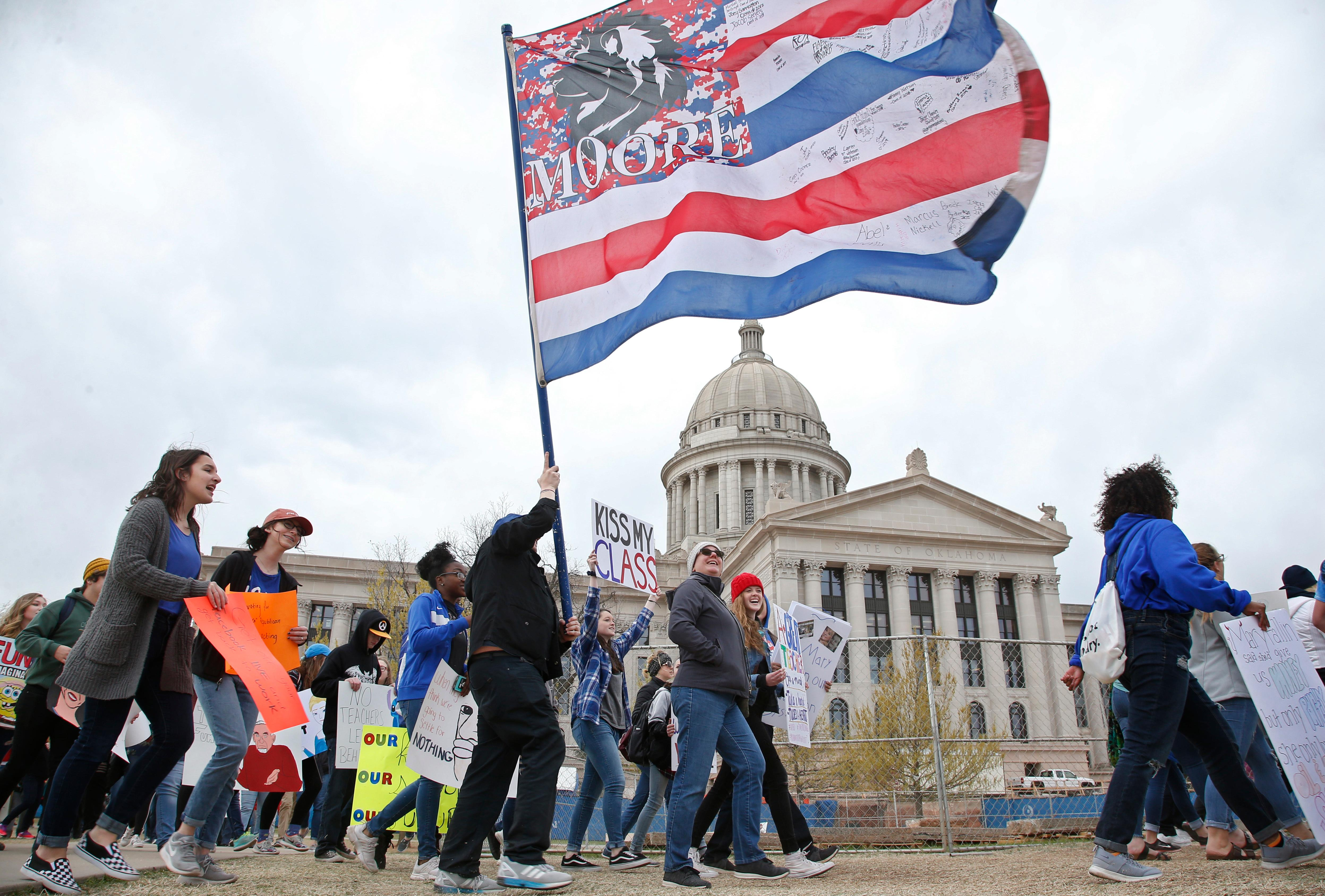 Students march around the state Capitol on the fourth day of protests over school funding, in Oklahoma City, Thursday, April 5, 2018. (AP Photo/Sue Ogrocki)