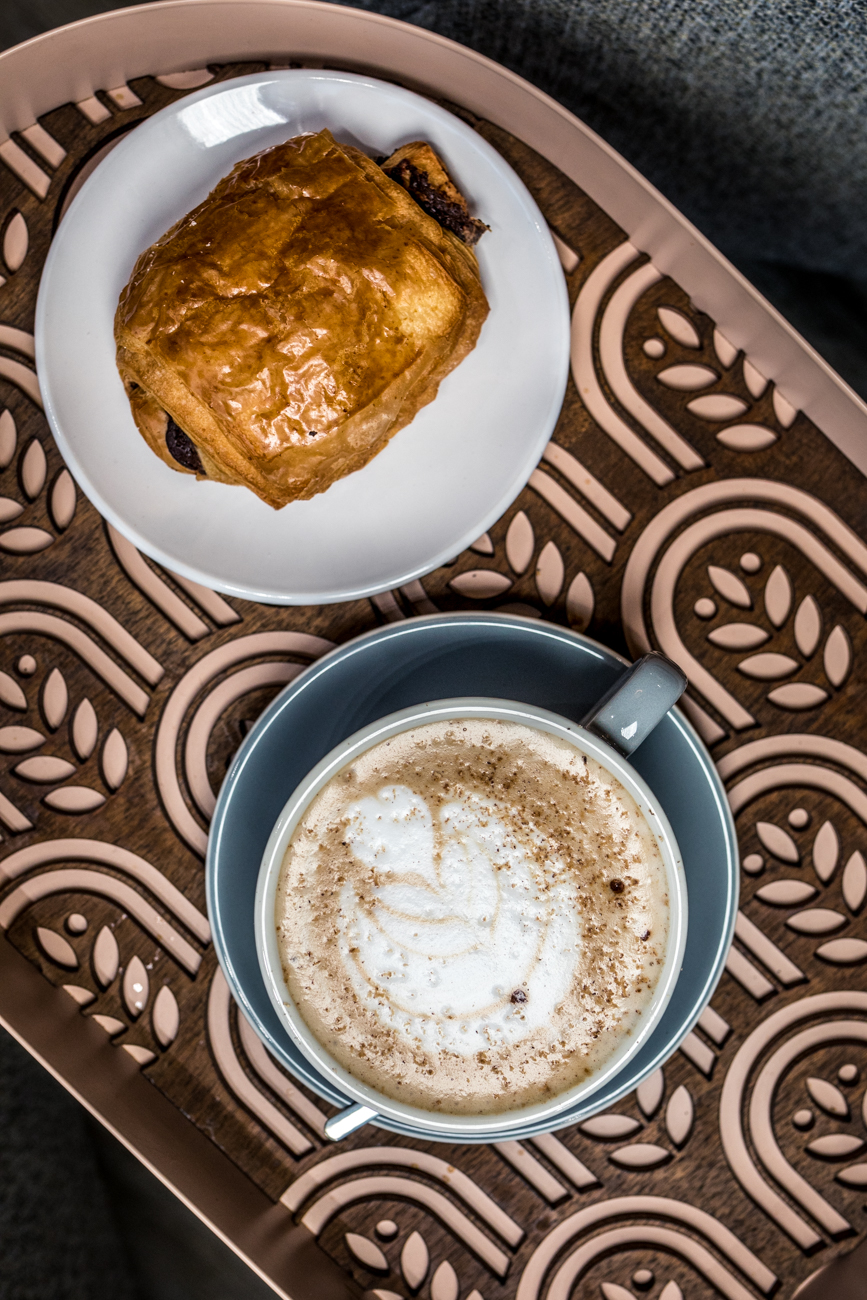 A North South Baking Co. chocolate croissant and a spiced chai latte / Image: Catherine Viox{ }// Published: 8.5.20