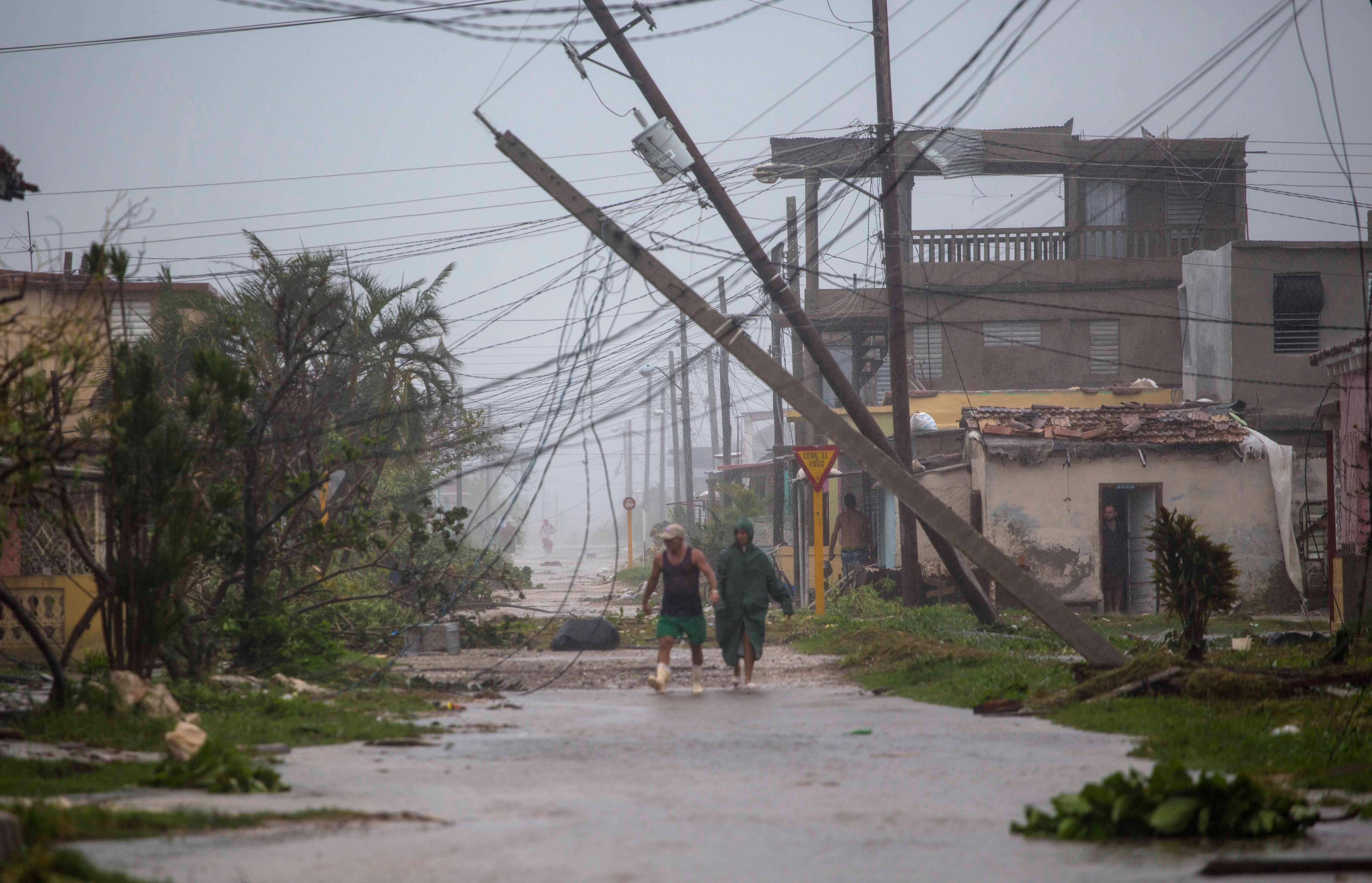 Residents venture out after the passing of Hurricane Irma in Caibarien, Cuba, Saturday, Sept. 9, 2017. There were no reports of deaths or injuries after heavy rain and winds from Irma lashed northeastern Cuba. Seawater surged three blocks inland in Caibarien. (AP Photo/Desmond Boylan)