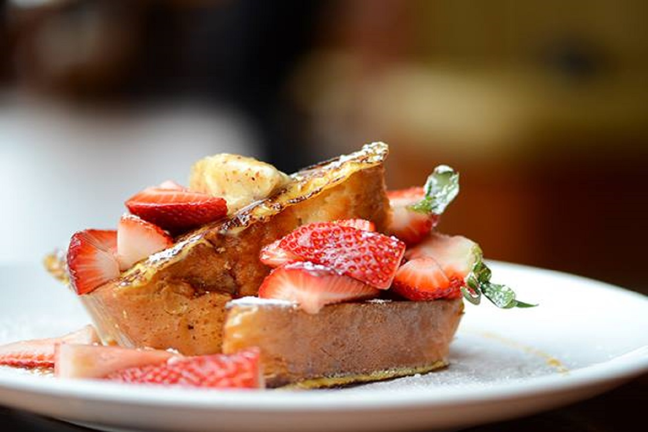 What's better than French Toast with strawberries? How about Creme Caramel French Toast with strawberries and Pecan Butter. That's the deliciously decadent dish you'll find at Toulouse Petit on their exceptional breakfast menu. (Image Courtesy: Toulouse Petit Kitchen & Lounge Facebook Page)