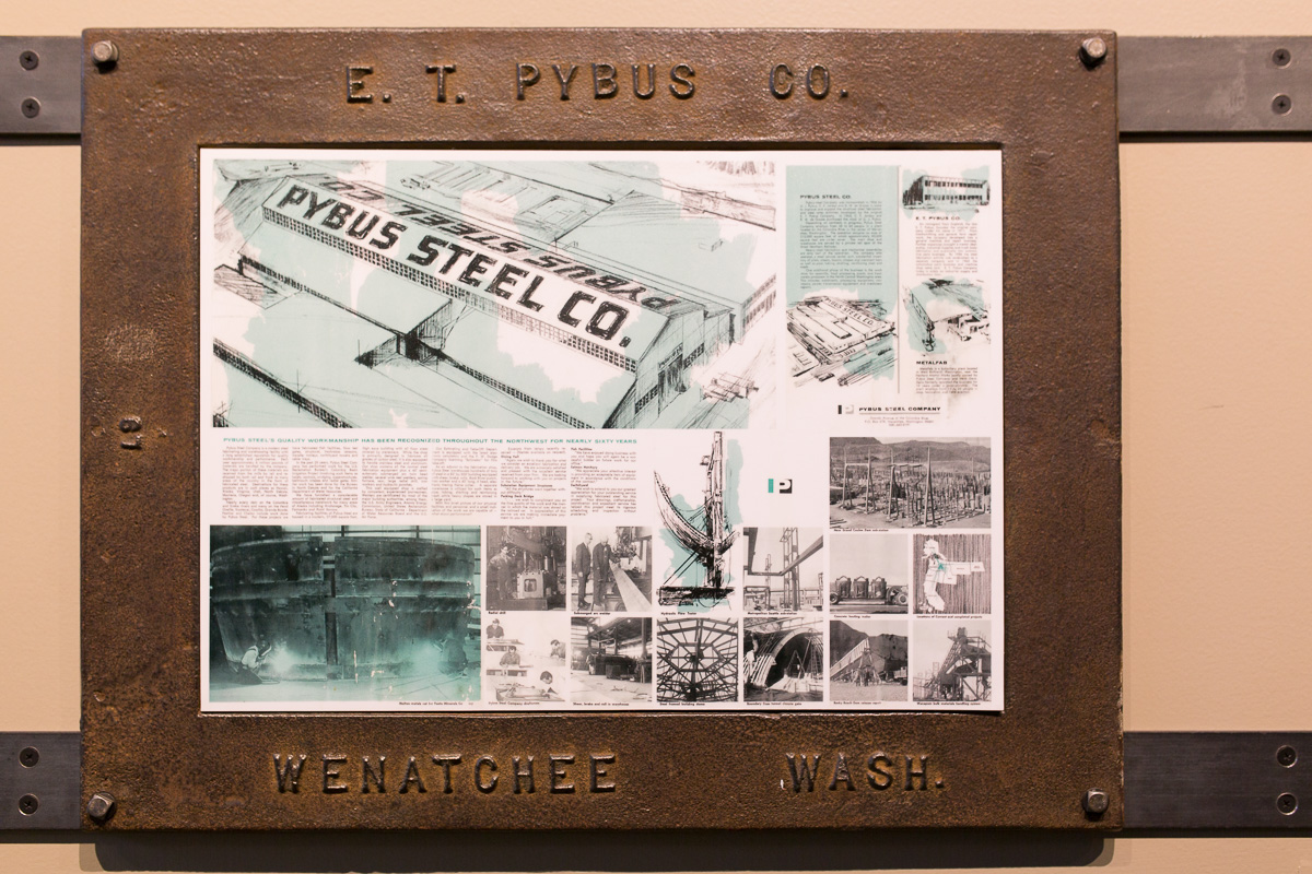 The history of Pybus market framed with Pybus-made drain covers. (Image: Paola Thomas / Seattle Refined)
