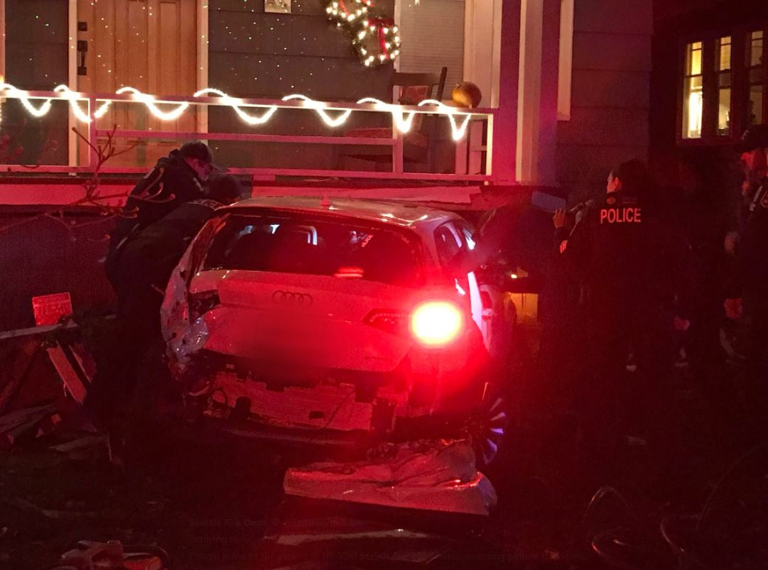 Emergency crews freed a driver trapped in a stolen car Monday night after it hit a natural gas line and smashed into a house in the University District.{&amp;nbsp;} (Photo: Seattle Fire)<p></p>