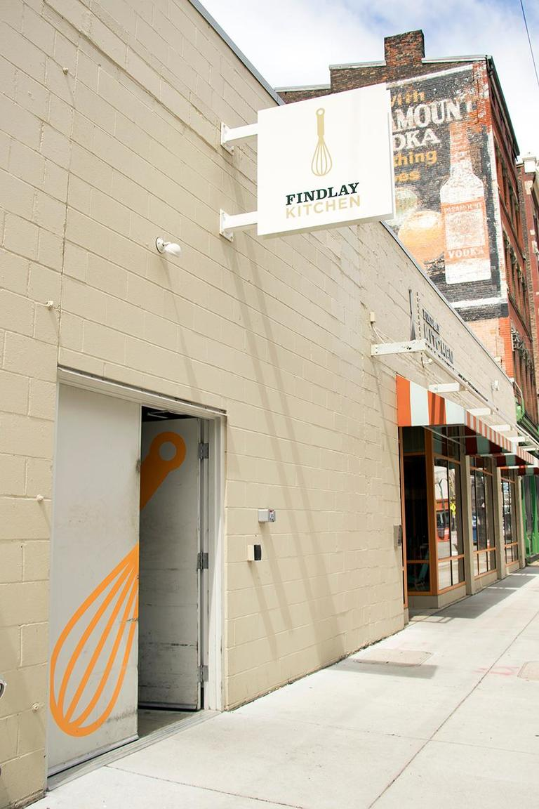 Findlay Kitchen is a non-profit food business incubator located in the heart of the historic Findlay Market district. The kitchen is a mission-driven organization that places special emphasis on cultivating women, immigrant, and minority-owned businesses, which currently comprise 80% of their member community. Findlay Kitchen supports food entrepreneurs looking to start, grow, and scale their business by providing affordable access to 11 licensed commercial kitchens, commercial-grade kitchen equipment, and ample storage space. The facility is designed and built with maximum flexibility in mind for their members whether they are just starting out or are looking to scale their current operation. ADDRESS: 1719 Elm Street (45202) / Image: Allison McAdams // Published: 5.10.18
