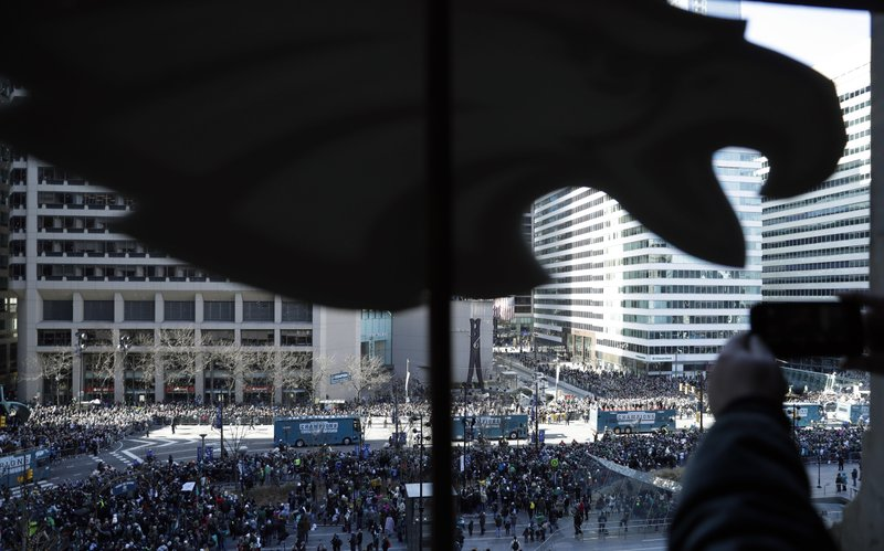 <p>A fan takes a photo as the Philadelphia Eagles parade up Broad Street during a Super Bowl victory parade, Thursday, Feb. 8, 2018, in Philadelphia. The Eagles beat the New England Patriots 41-33 in Super Bowl 52. (AP Photo/Matt Slocum)</p>