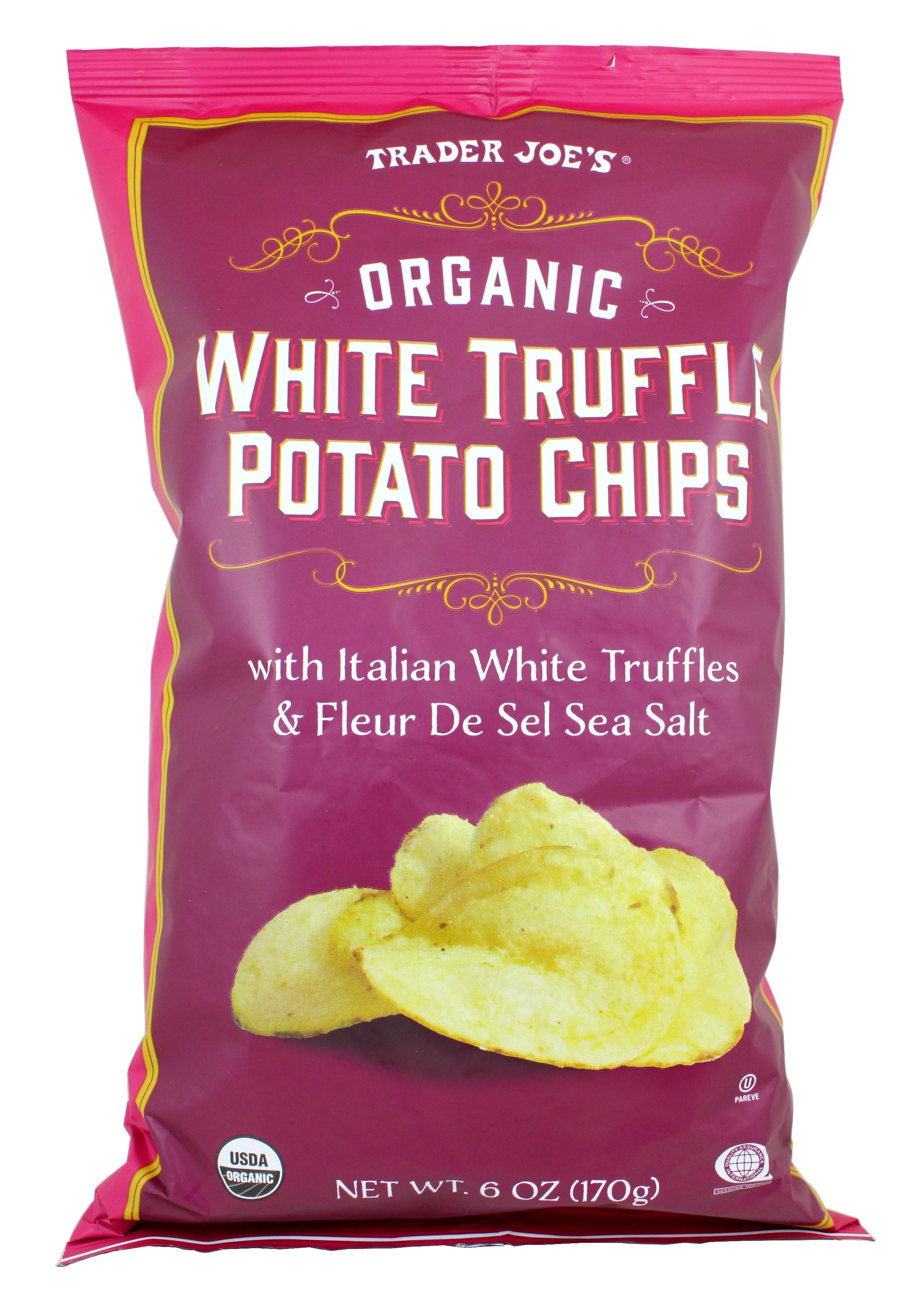 "Organic White Truffle Potato Chips. If it has truffle on it, I'm trying it. And these chips? Wow! Such a delicious chip treat! The Salt & Vinegar and HIckory Barbeque chips aren't too shabby either. On a monthly basis I rotate through three grocery stops - Costco, Walmart Pick-up, and Trader Joe's. And, you guessed it, Trader Joe's is my favorite. Do you love it too? I have classic staples there and am always finding new favorites. That's the joy things there follow the old adage ""Make new friends but keep the old"". How they smoosh so many amazing products into their few rows, I will never know, but I no doubt discover fabulous things ever time my red cart wanders through. (Image: Trader Joes)"