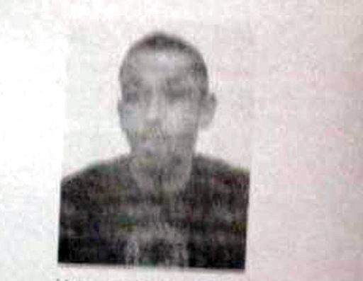 This photo provided by the AP on the condition that its source not be revealed, shows Karim Cheurfi. A gunman opened fire on police on Paris' iconic Champs-Elysees boulevard Thursday night, April 20, 2017.  Police have searched a home in a suburb east of Paris believed linked to the attack on police on the Champs-Elysees. A police document obtained by The Associated Press identifies the address searched in the town of Chelles as the family home of Karim Cheurfi, a 39-year-old with a police record. (AP Photo)