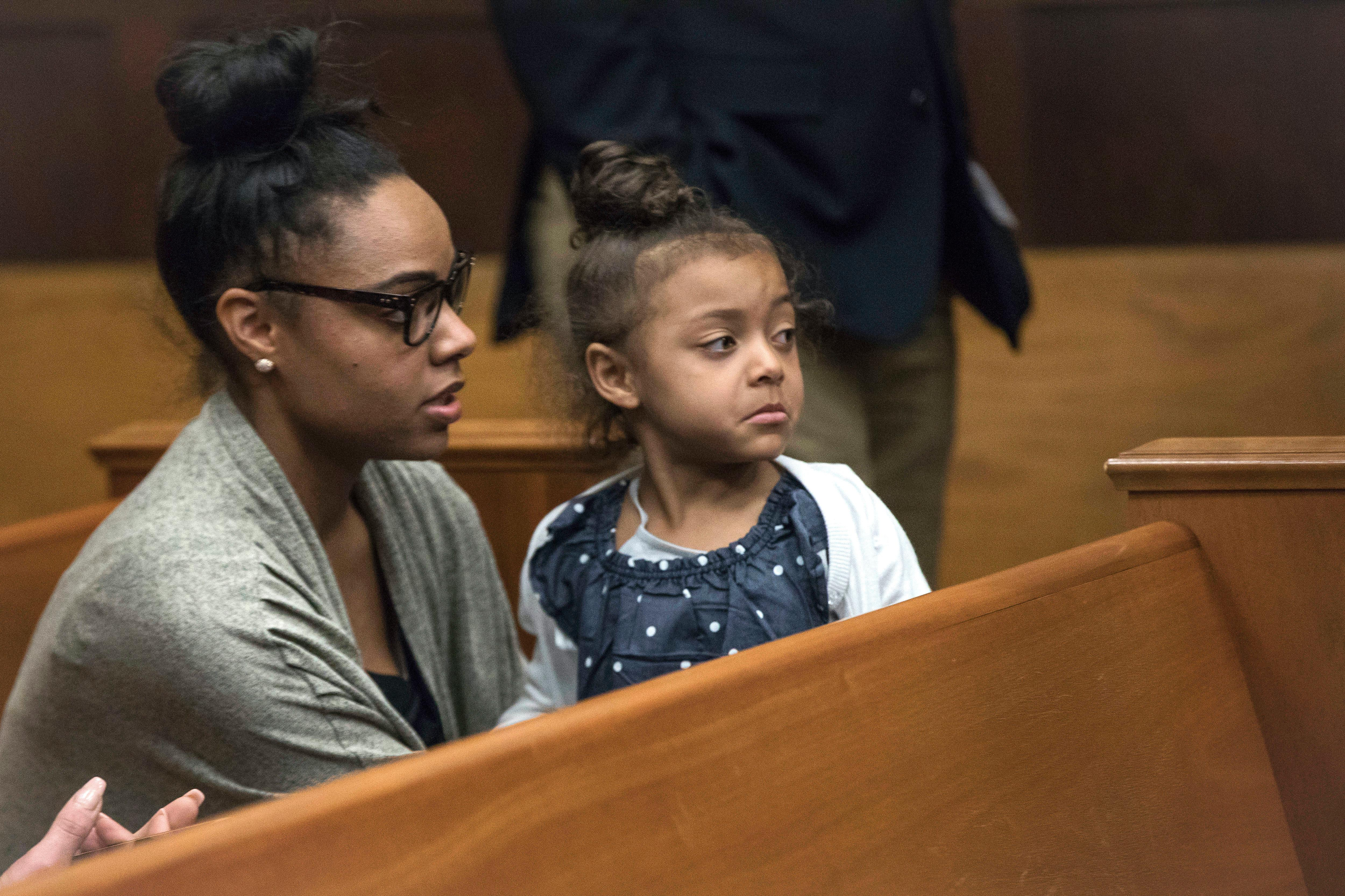 FILE - In this Wednesday, April 12, 2017, file photo, Shayanna Jenkins Hernandez, fiancee of former New England Patriots tight end Aaron Hernandez, sits in the courtroom with the couple's daughter during jury deliberations in Hernandez's double-murder trial at Suffolk Superior Court in Boston. Hernandez was acquitted of those crimes on Friday, but hanged himself in his prison early Wednesday, April 19, 2017, where he was serving a life sentence in the 2013 killing of semi-professional football player Odin Lloyd. (Keith Bedford/The Boston Globe via AP, Pool, File)