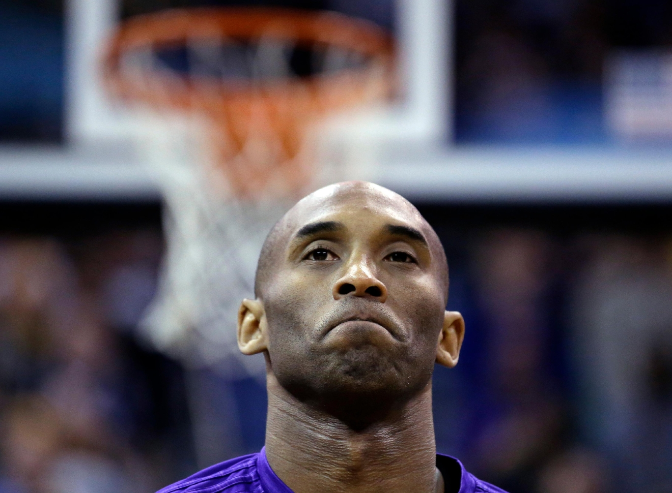 Los Angeles Lakers forward Kobe Bryant looks on before the start of an NBA basketball game against the Utah Jazz, Monday, March 28, 2016, in Salt Lake City. (AP Photo/Rick Bowmer)