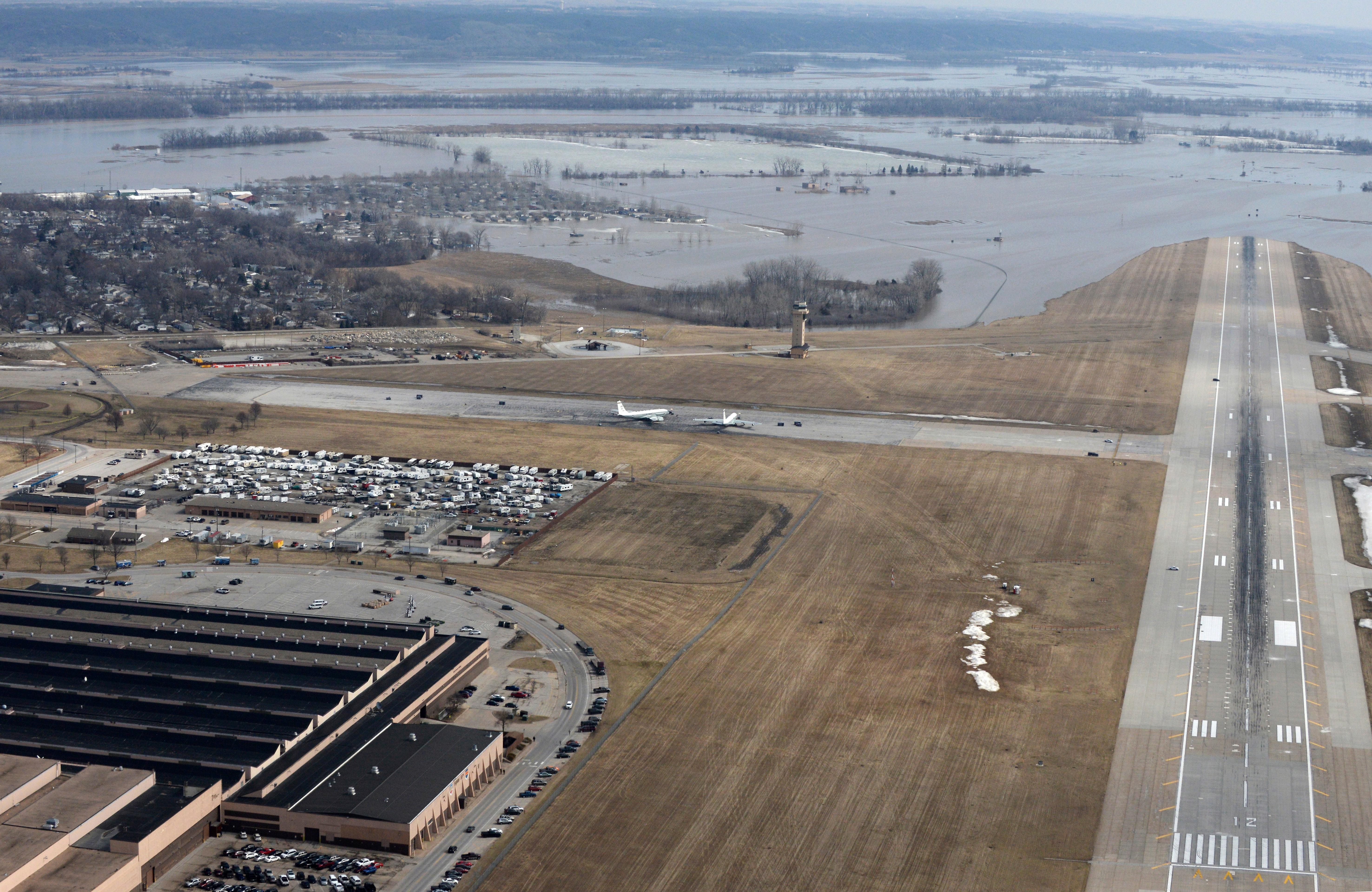 This March 17, 2019 photo released by the U.S. Air Force shows an aerial view of Offutt Air Force Base and the surrounding areas affected by flood waters in Neb.. (Tech. Sgt. Rachelle Blake/The U.S. Air Force via AP)