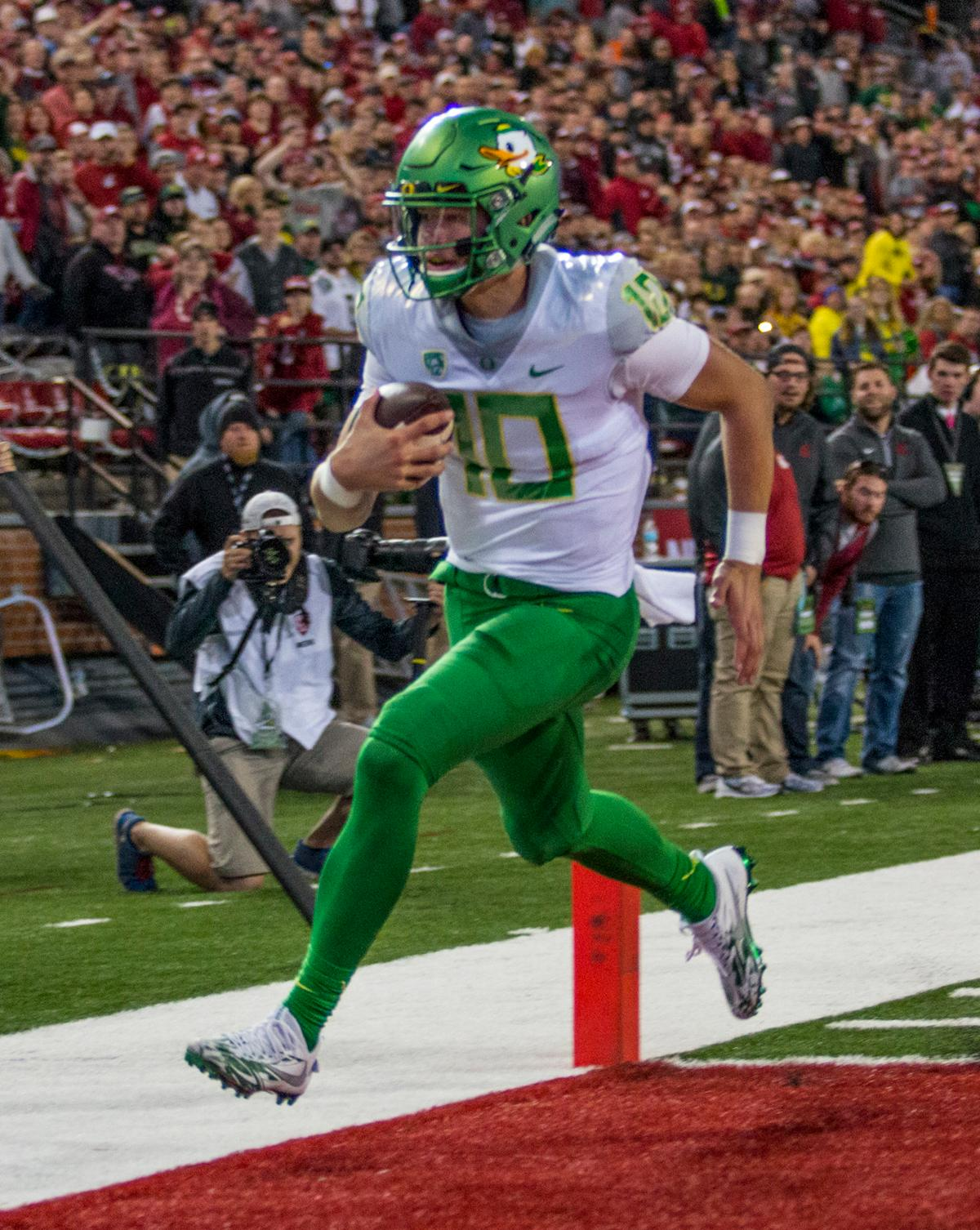 Oregon Ducks quarterback Justin Herbert (#10) scores a touchdown late in the fourth quarter against the Washington State Cougars. The Cougars beat the Ducks 51-33 at Martin Stadium on Saturday evening. Photo by Katie Pietzold