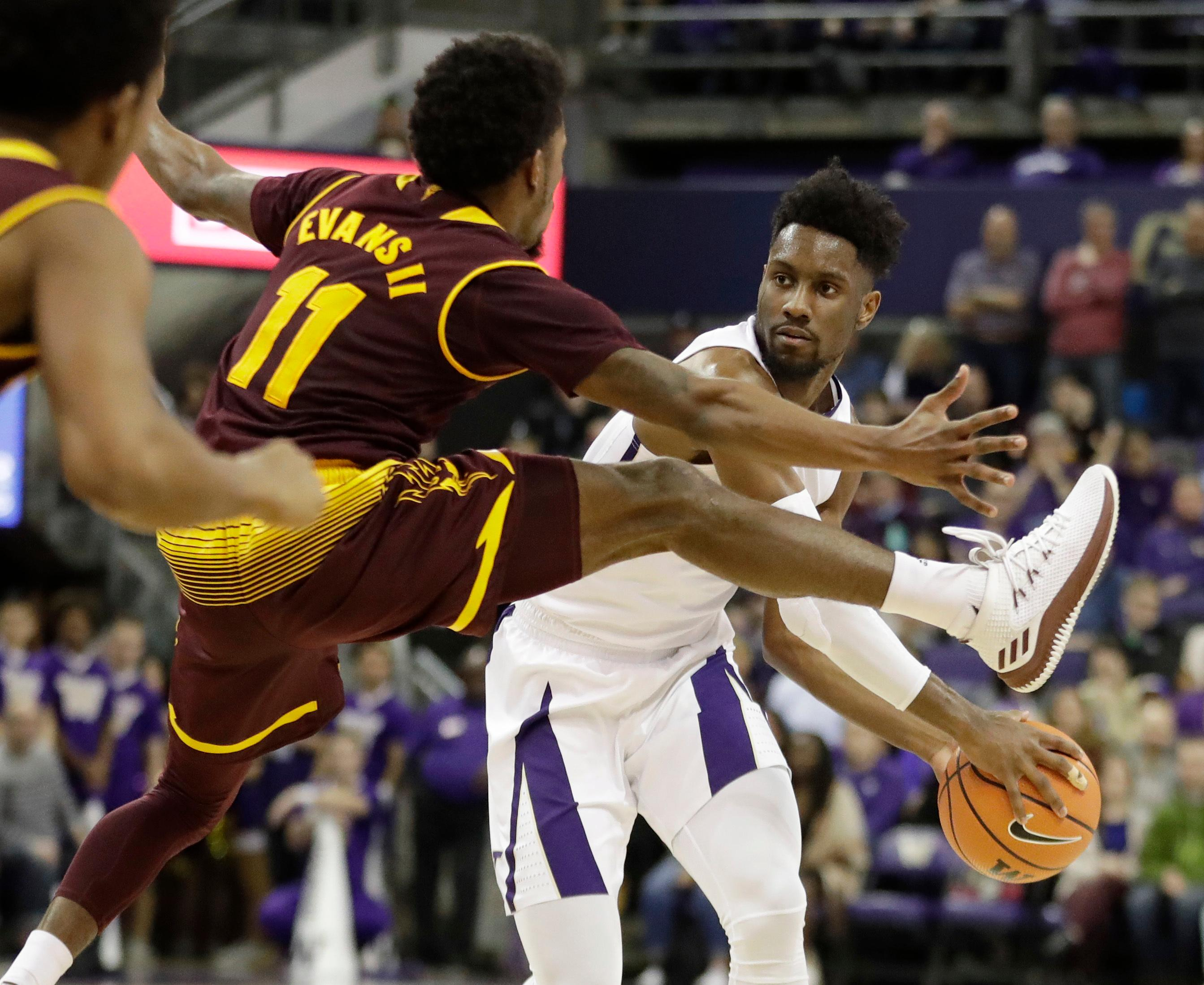 Arizona State guard Shannon Evans II (11) tries to block a pass by Washington guard Jaylen Nowell, right, in the first half of an NCAA college basketball game, Thursday, Feb. 1, 2018, in Seattle. (AP Photo/Ted S. Warren)