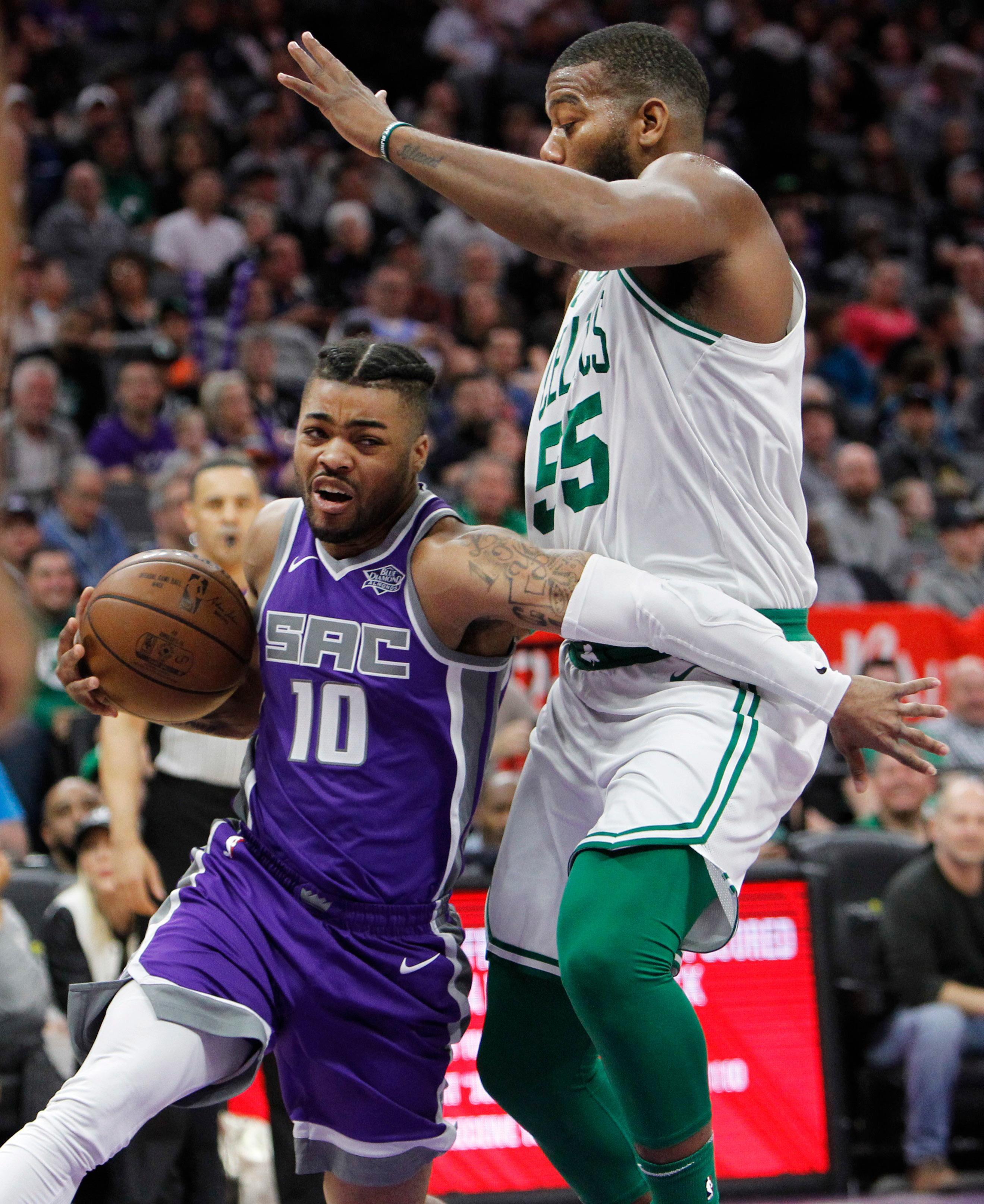 Sacramento Kings guard Frank Mason III (10) drives around Boston Celtics center Greg Monroe (55) during the first half of an NBA basketball game in Sacramento, Calif., Sunday, March 25, 2018. (AP Photo/Steve Yeater)