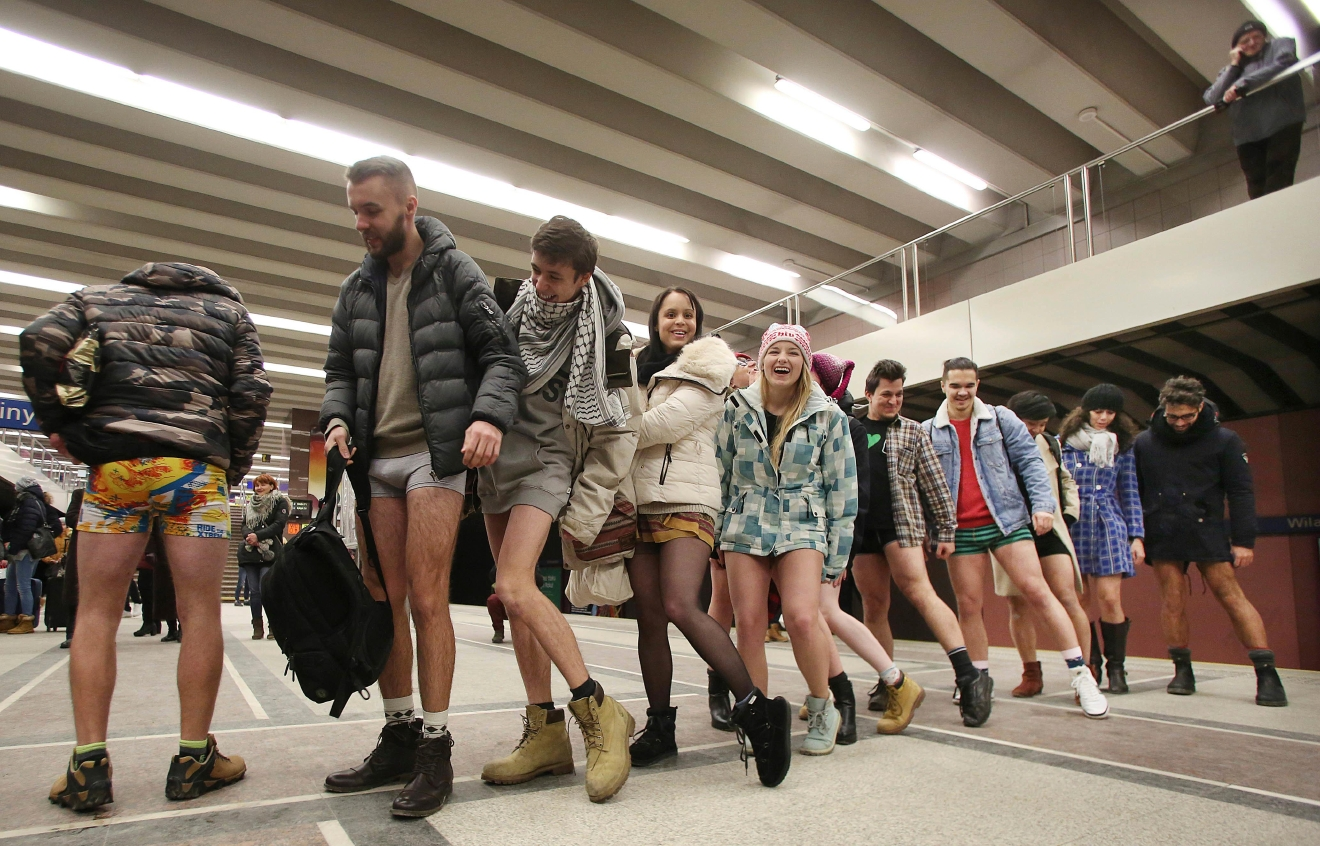 Young wait to ride  on the subway with no pants on as they join a global happening in Warsaw, Poland, Sunday, Jan. 8, 2017, amid freezing winter weather outside. (AP Photo/Czarek Sokolowski)