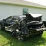 Car crash lands both cars on residential lawns in Port St. Lucie