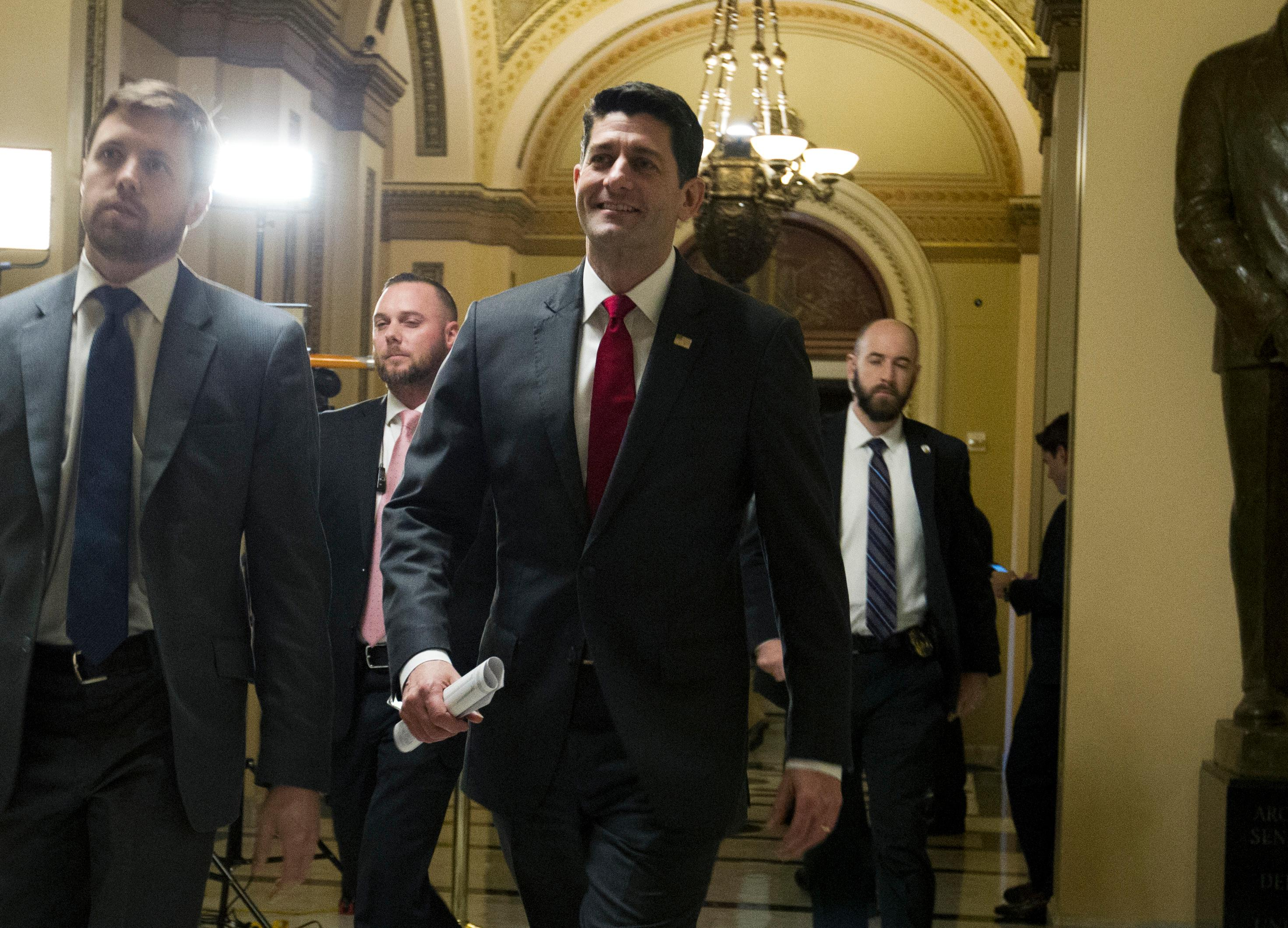 House Speaker Paul Ryan of Wis., walks to his office at the Capitol, Thursday, Feb. 8, 2018, in Washington., as lawmakers pushed to enact a massive budget deal along with a stopgap temporary measure to prevent a government shutdown at midnight. (AP Photo/Jose Luis Magana)