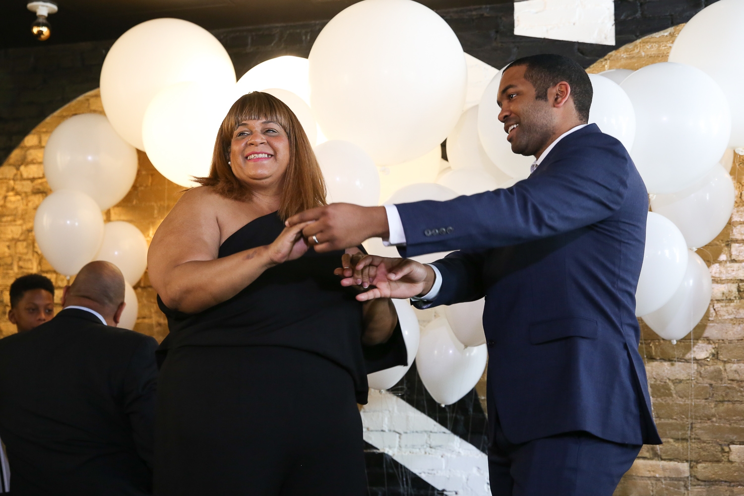 Antonio Proctor shared a dance with his new mother-in-law.{ }(Amanda Andrade-Rhoades/DC Refined)