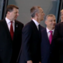 President Donald Trump appears to physically push aside NATO leader