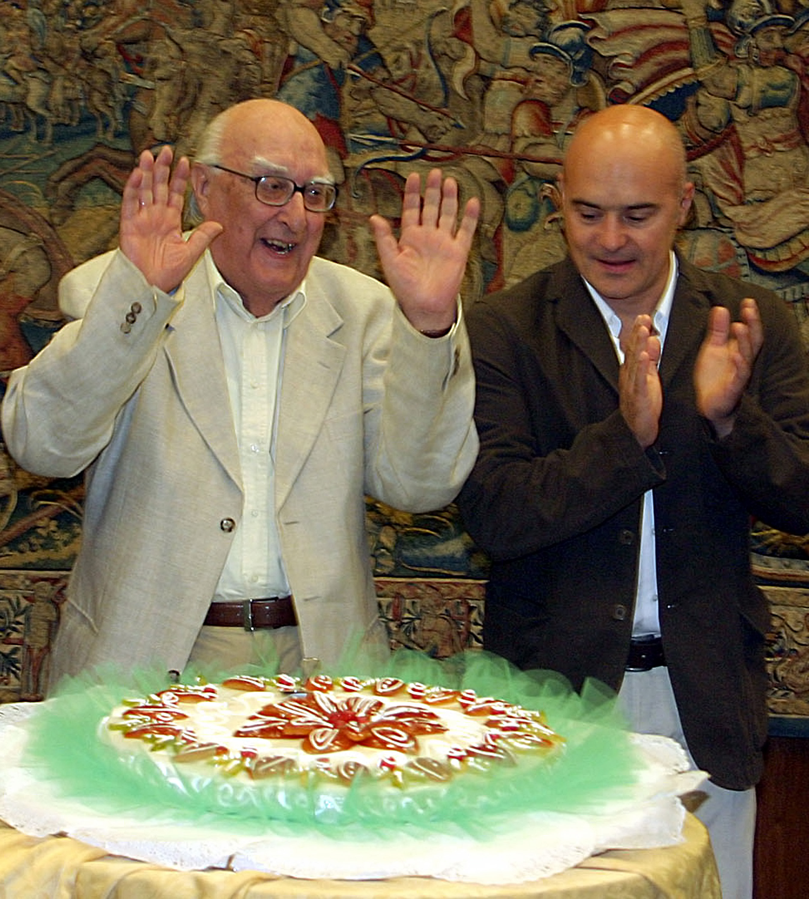 FILE - In this Sept. 14, 2005 file photo, Italian author Andrea Camilleri, left, flanked by actor Luca Zingaretti, celebrates his 80th birthday, at the RAI headquarters, in Rome.(AP Photo/Sandro Pace, file)
