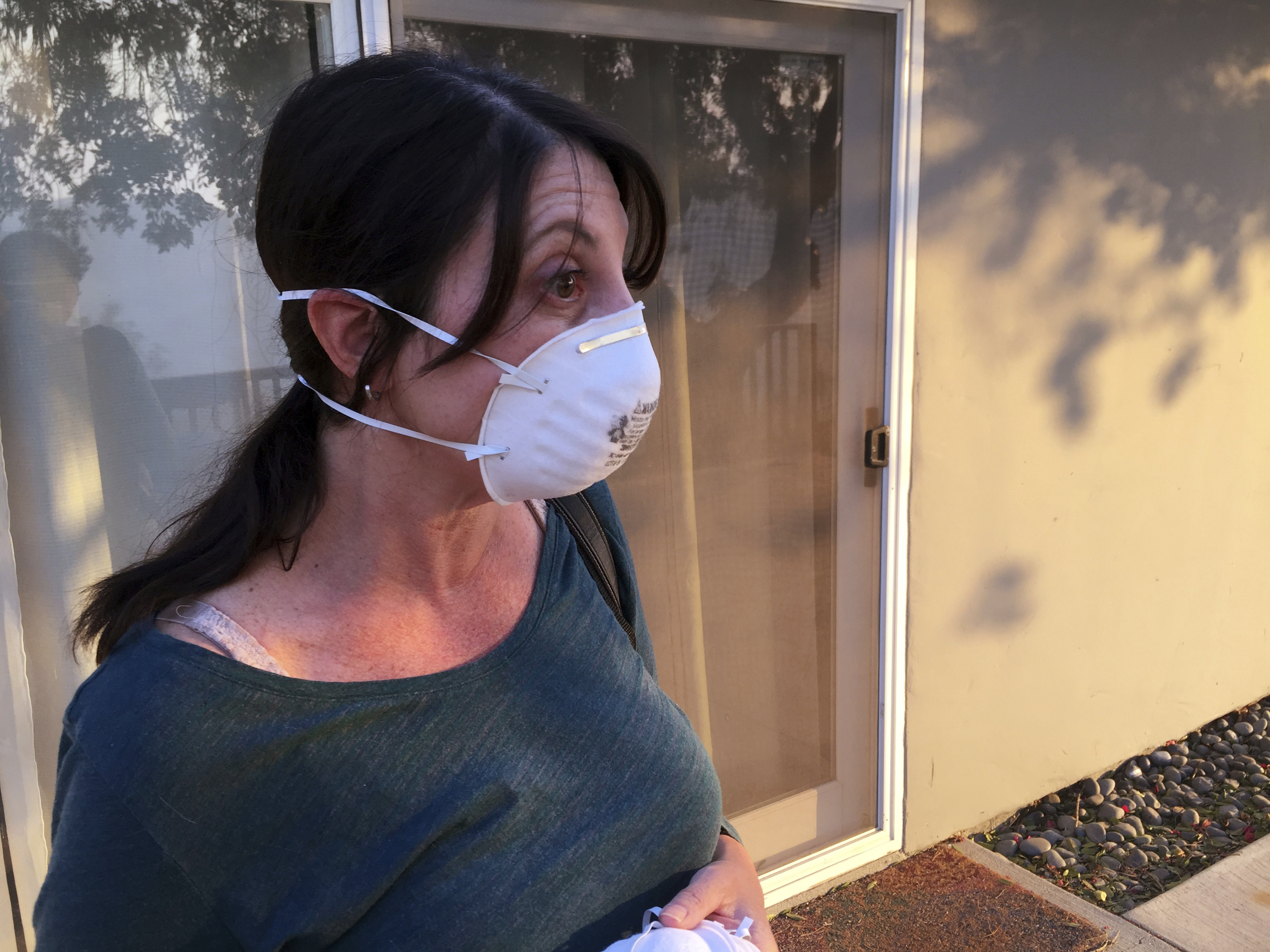 Resident Melissa Rosenzweig worries about losing her family home in the second round of weather coming in Ventura, Calif., Wednesday, Dec.6, 2017. The Rosenzweig's house nearly didn't make it this last time, and the house across the street from them burnt down in the Thomas Fire. Wind-driven fires have raced through California communities for the second time in two months, leaving hundreds of homes feared lost and uprooted tens of thousands of people. The most damaging fire is in Ventura County northwest of Los Angeles, where more than 100 square miles (259 sq. kilometers) and numerous homes have burned. (AP Photo/Amanda Lee Myers)