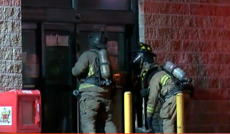 First responders fight fire at Mr. B's grocery store in Flint.{ }(Photo: WEYI/WSMH)