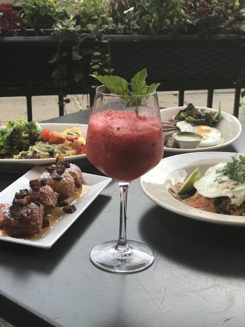 Watermelon and basil are the epitome of summer, so they're the perfect pairing for the slush at Logan Tavern ($10). The two ingredients are used to infuse vodka, which is then frozen, shaved finely, and topped with sparkling wine and fresh basil. (Image: Courtesy Logan Tavern)