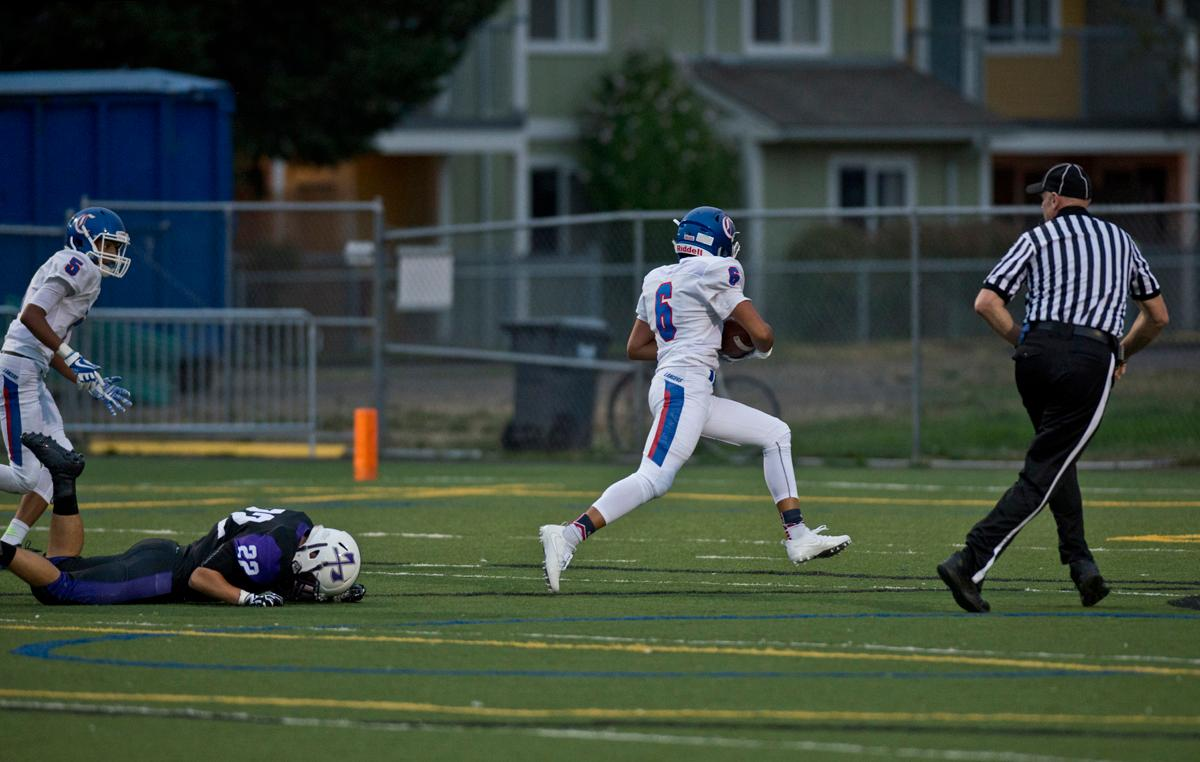 Churchill Lancers Elijah Fields (#6) sprints into the endzone for a touchdown. The Churchill Lancers defeated the South Eugene Axemen 38-6 in the South Eugene opening home game at Morrow Field. Photo by Dan Morrison, Oregon News Lab