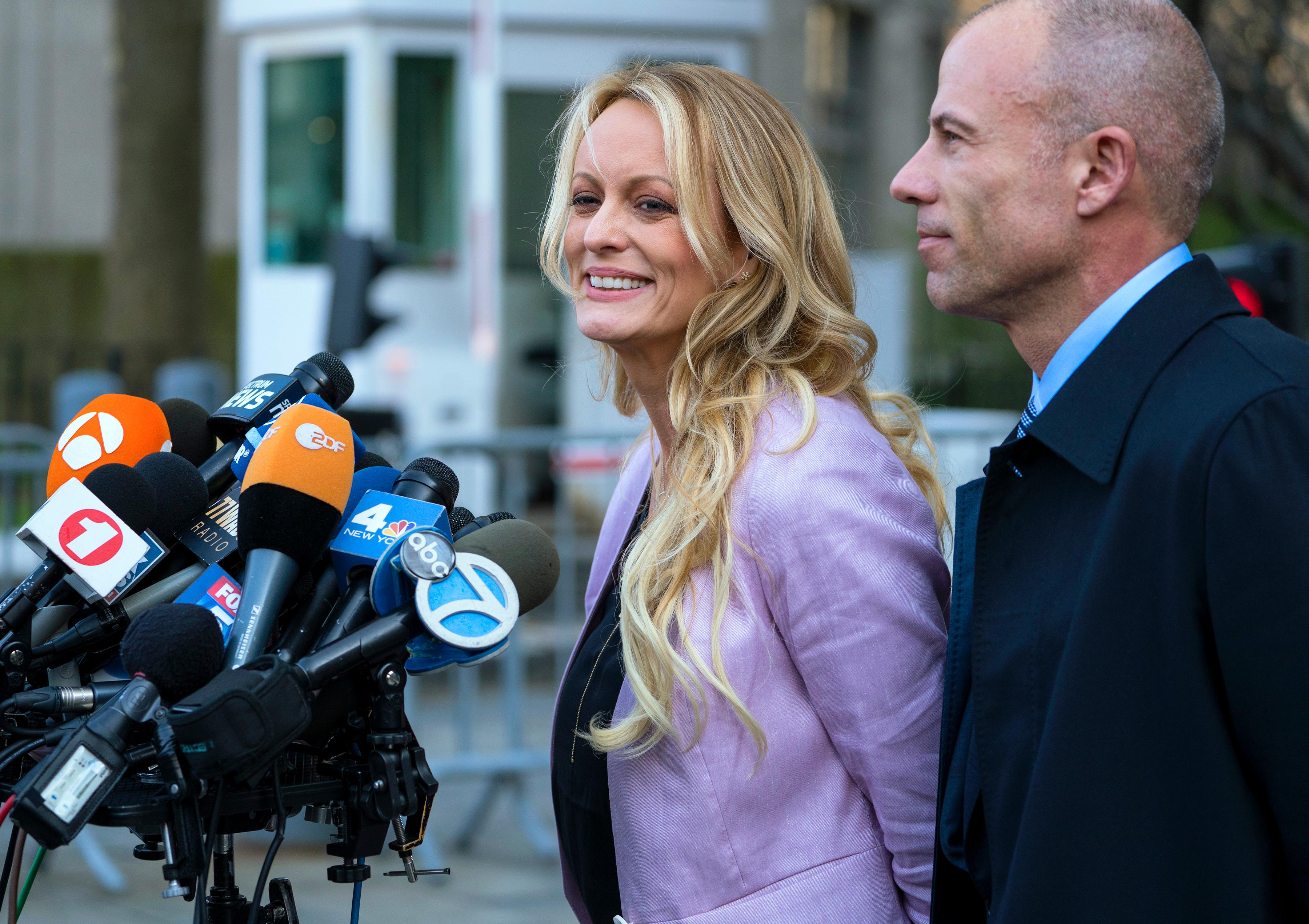 Adult film actress Stormy Daniels speaks to members of the media after a hearing at federal court, Monday, April 16, 2018, in New York, as she is accompanied by her attorney Michael Avenatti.  A judge considering how to handle records seized in an FBI raid on the home and office of Michael Cohen, President Donald Trump's personal attorney, wrapped up a hearing into the matter Monday without making a final decision. The search sought information on a variety of matters, including a $130,000 payment made to Daniels, who alleges she had sex with Trump in 2006. (AP Photo/Craig Ruttle)