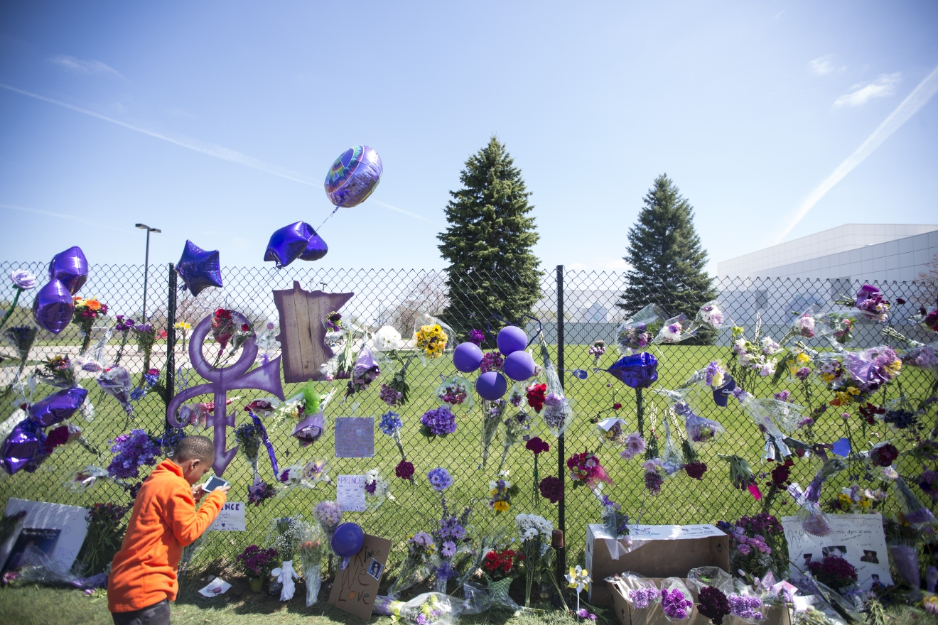 "The memorial for Prince is set up on the fence outside his home at Paisley Park Friday, April 22, 2016, in Chanhassen, Minn. Prince, widely acclaimed as one of the most inventive and influential musicians of his era with hits including ""Little Red Corvette,"" ""Let's Go Crazy"" and ""When Doves Cry,"" was found dead at his home on Thursday in suburban Minneapolis, according to his publicist. He was 57. (Renee Jones Schneider/Star Tribune via AP)  MANDATORY CREDIT; ST. PAUL PIONEER PRESS OUT; MAGS OUT; TWIN CITIES LOCAL TELEVISION OUT"