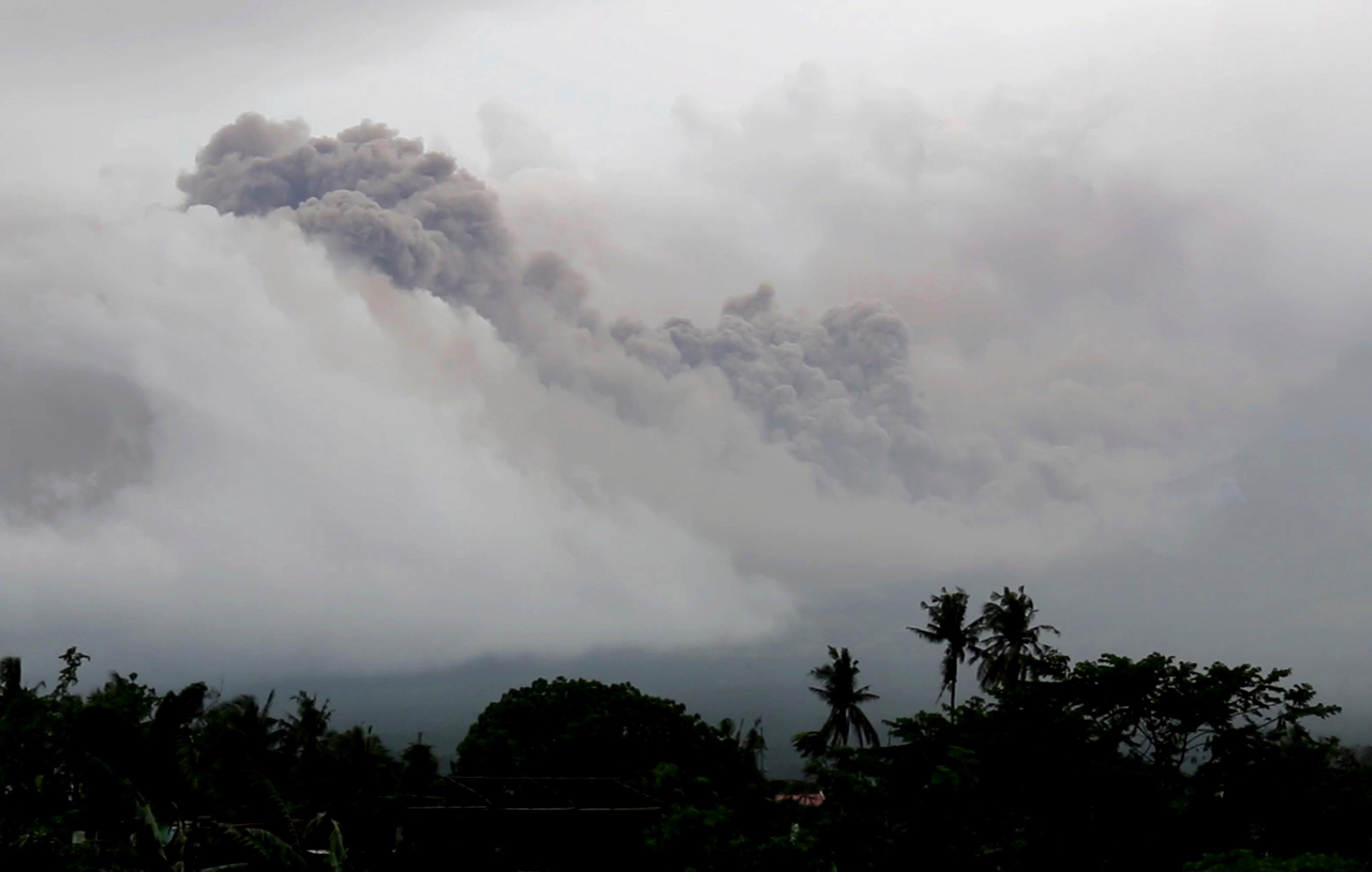 In this image made from video, dark pyroclastic ash cloud rises from Mayon volcano after its eruption as seen from Legazpi city, Albay province, around 340 kilometers (200 miles) southeast of Manila, Philippines, Monday, Jan. 15, 2018. More than 9,000 people have evacuated the area around the Philippines' most active volcano as lava flowed down its crater Monday in a gentle eruption that scientists warned could turn explosive. (AP Photo)